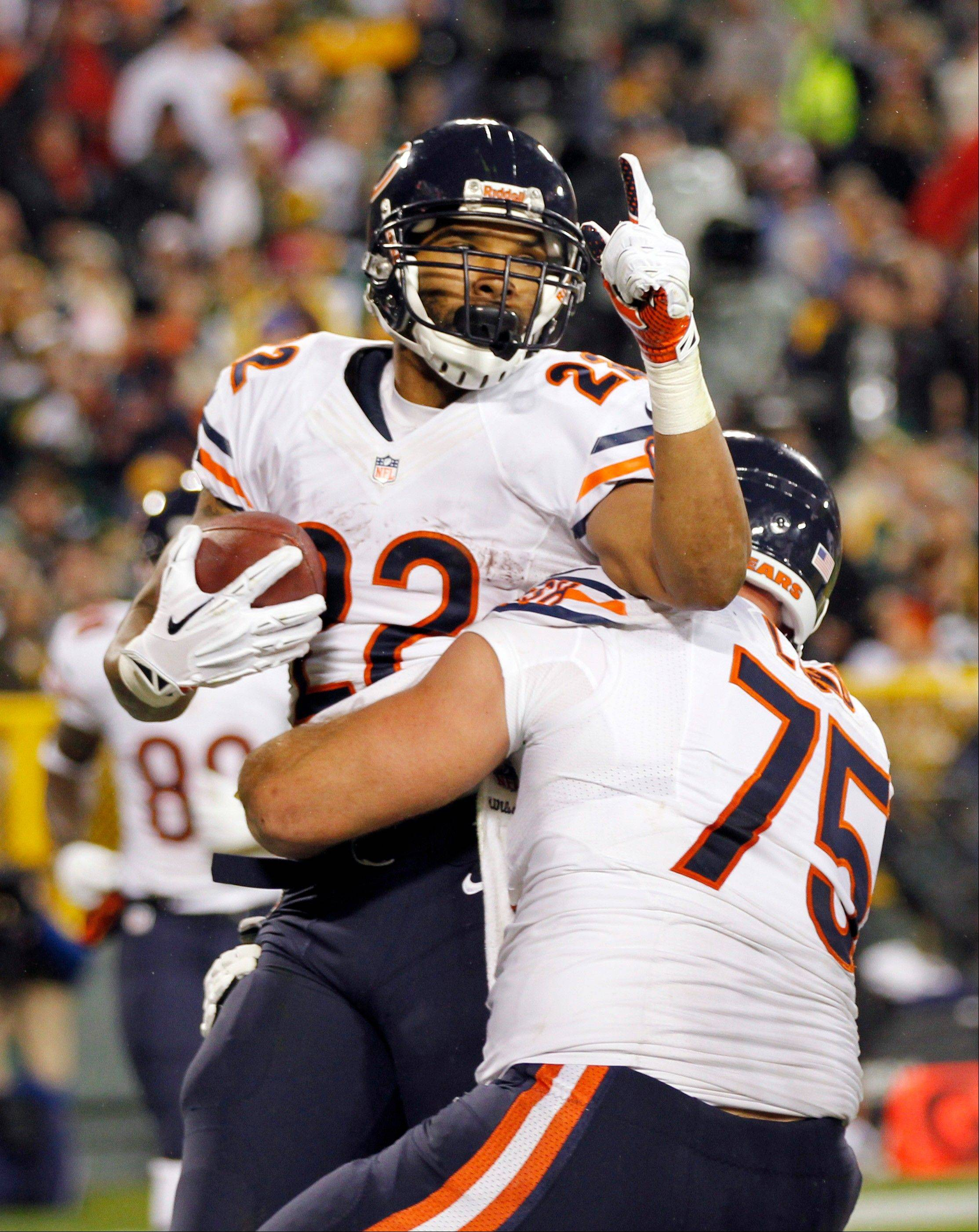 Chicago Bears' Matt Forte (22) celebrates his touchdown run with teammate Kyle Long (75) during the first half of an NFL football game against the Green Bay Packers Monday, Nov. 4, 2013, in Green Bay, Wis.