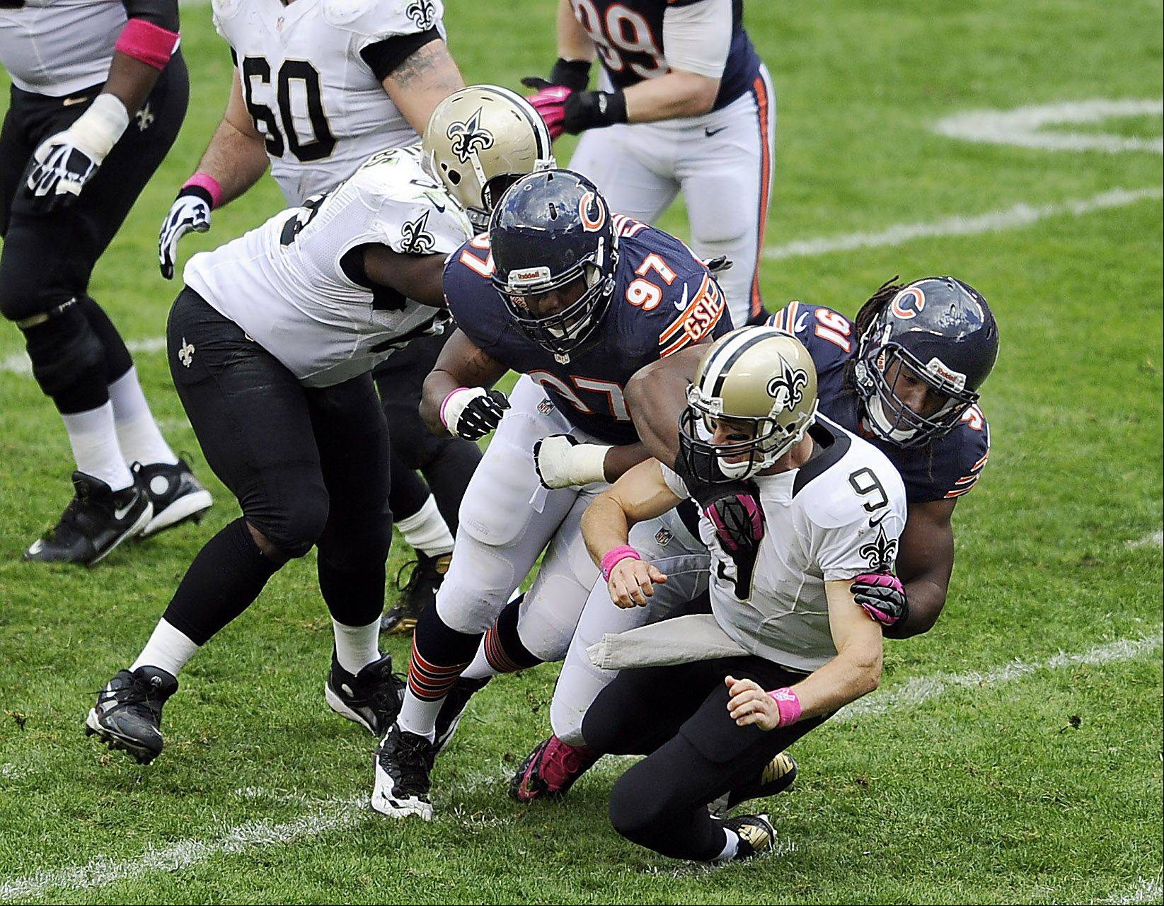 David Bass and Landon Cohen bring down Saints quarterback Drew Brees in the third quarter of New Orleans' 26-18 victory at Soldier Field earlier this season. Bass will likely start today for the injured Shea McClellin.