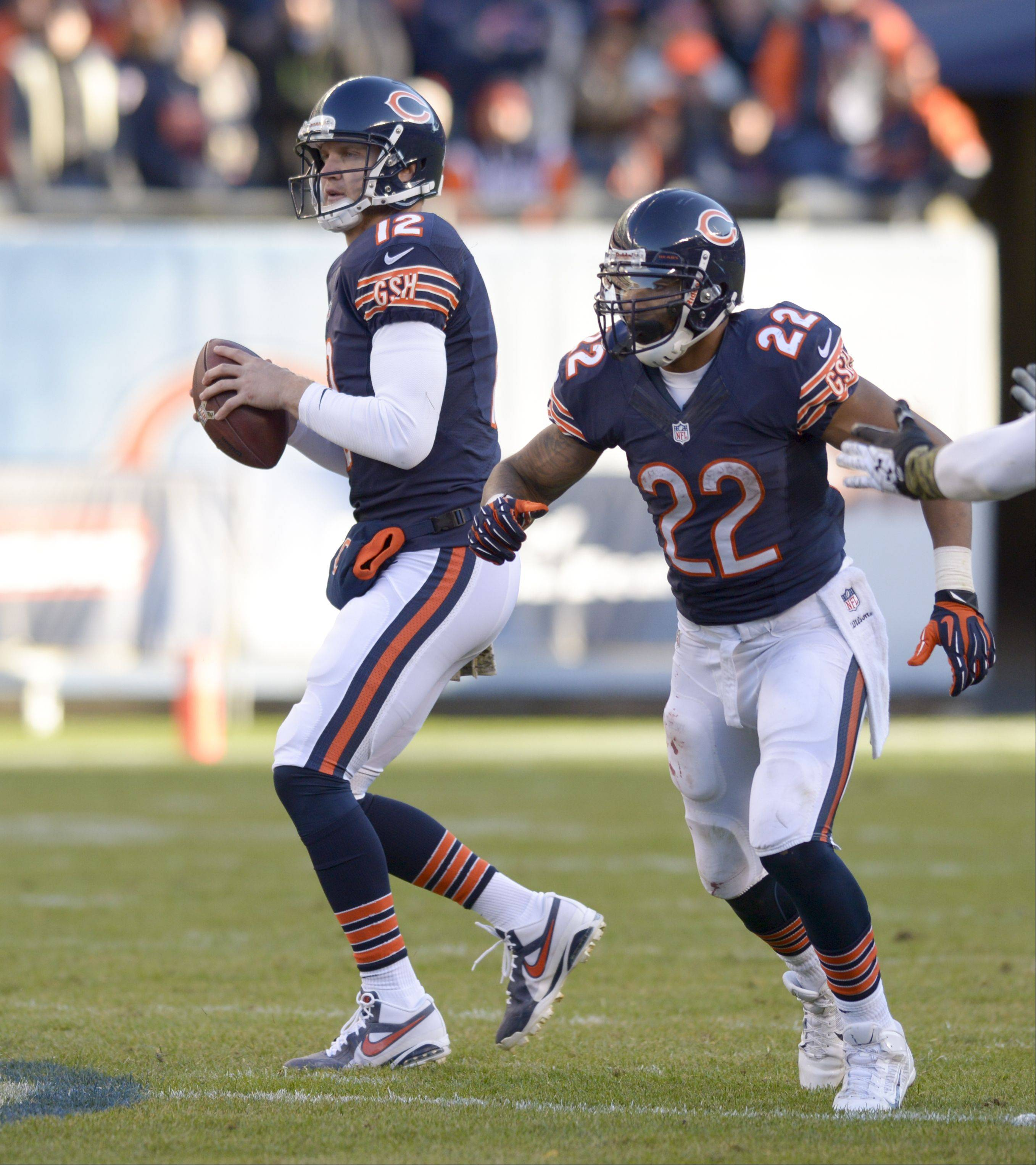 Josh McCown looks for an open receiver during the Bears� last drive Sunday against the Lions.