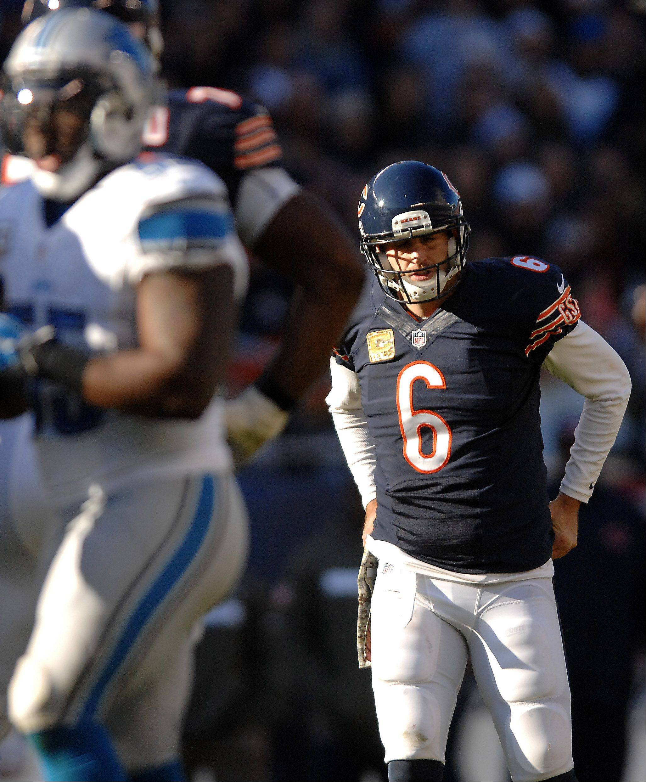 Jay Cutler gets up slowly after a third-quarter play during Sunday's loss to the Lions.
