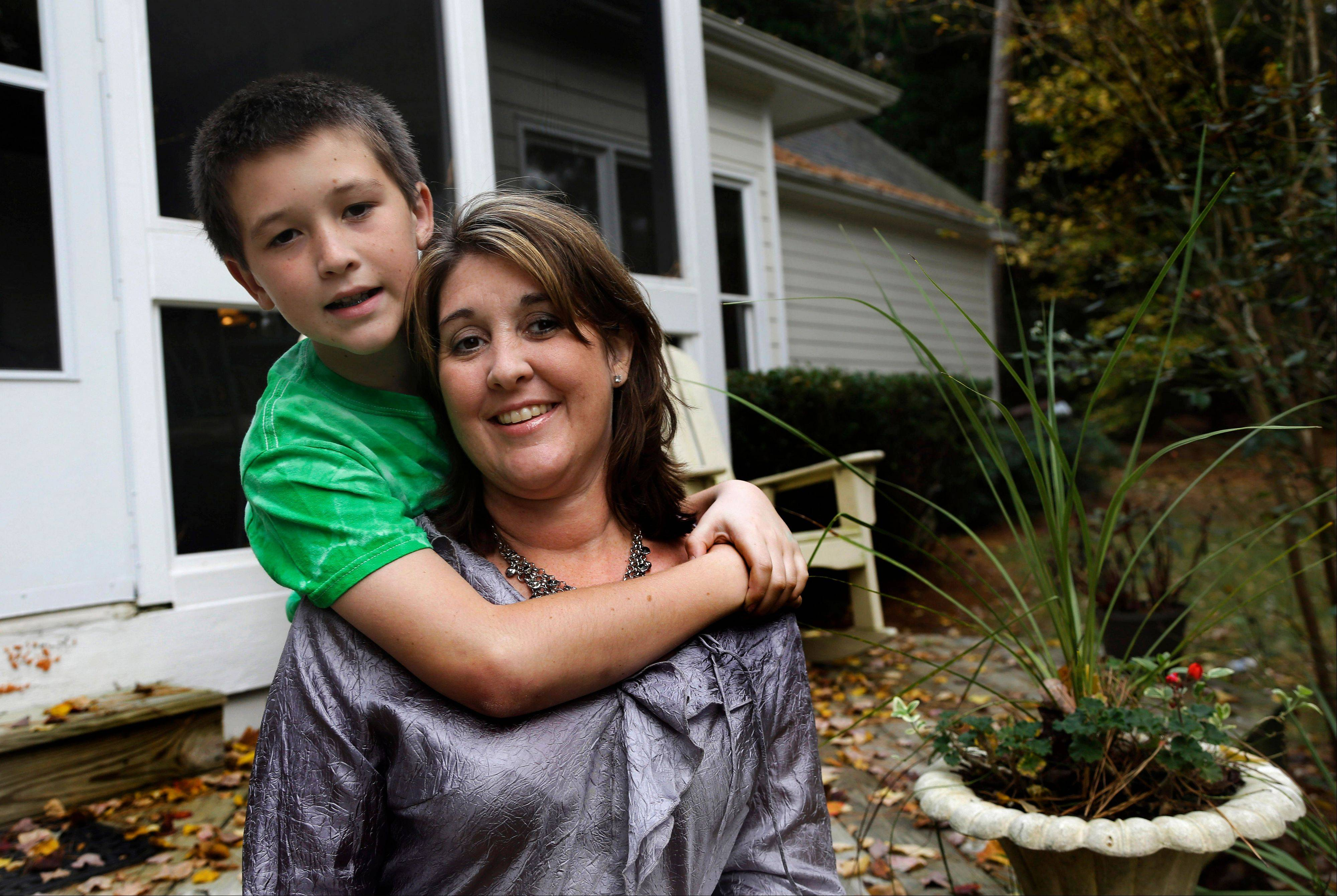 Jill Morin, right, with her son, Kyle, suffers from a serious heart condition and suffered a cardiac arrest in 2009. Morin and hundreds of thousands of other people with pre-existing chronic conditions who are covered through high risk insurance pools will see their coverage dissolve by year's end.
