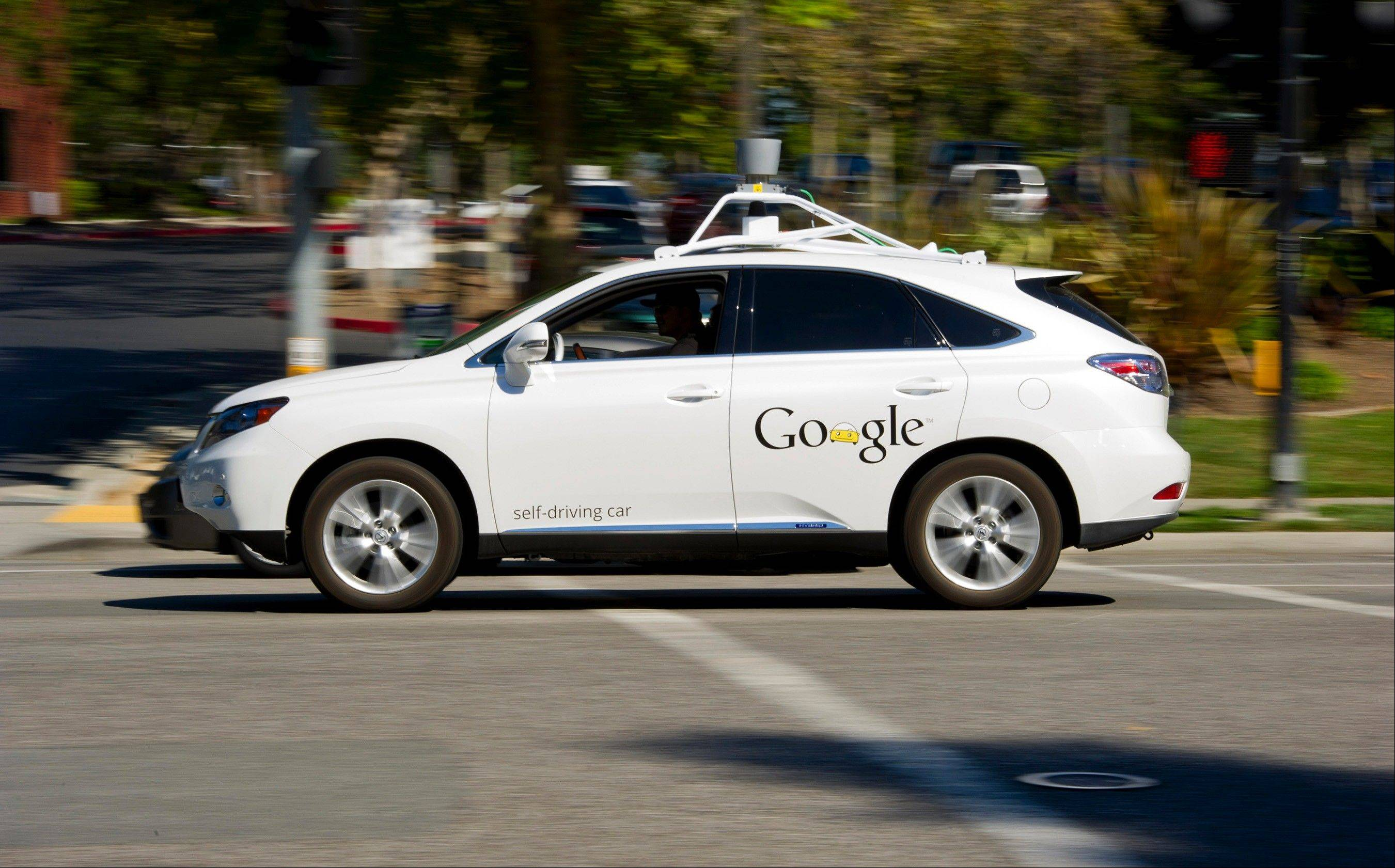 A man drives a Google self-driving car at the company's headquarters in Mountain View, Calif.