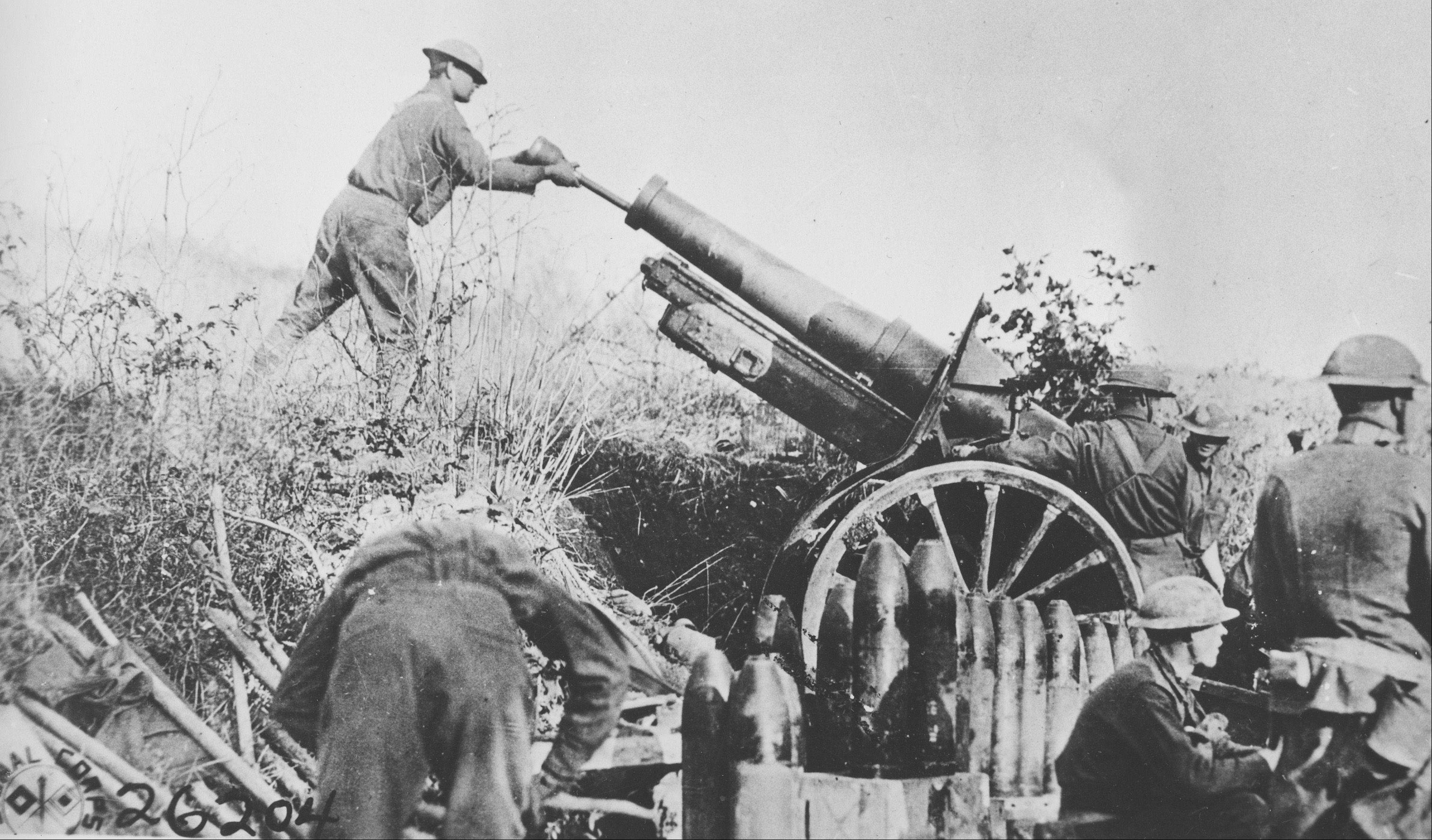 Associated Press File PhotoA U.S. artillery crew operates a 155mm gun in in France, during World War I, the so-called war to end all wars.