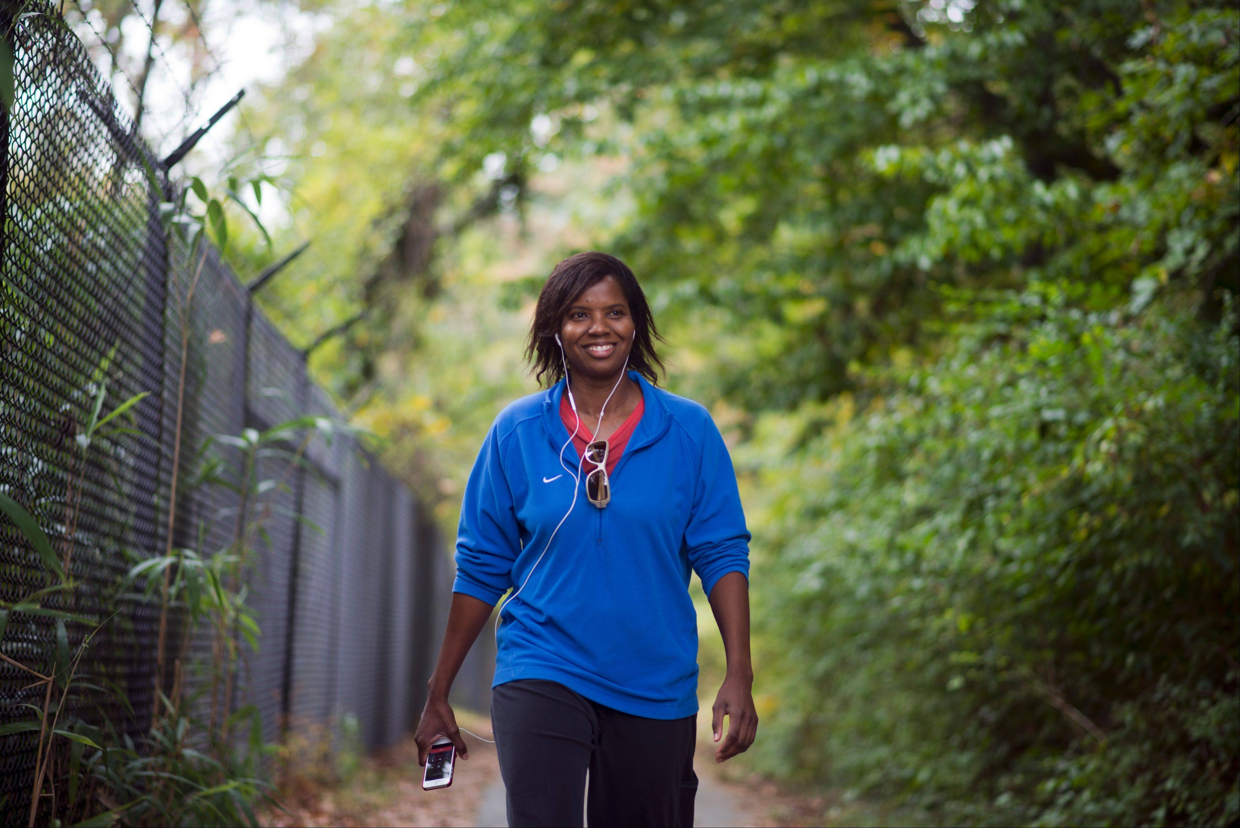 Olympic and World Cup soccer champion Briana Scurry walks in Rock Creek Park in Washington, D.C. on Oct. 22. After suffering a career-ending concussion in 2010, Scurry underwent brain surgery to relieve pressure on her occipital nerve, which ended her chronic headaches.