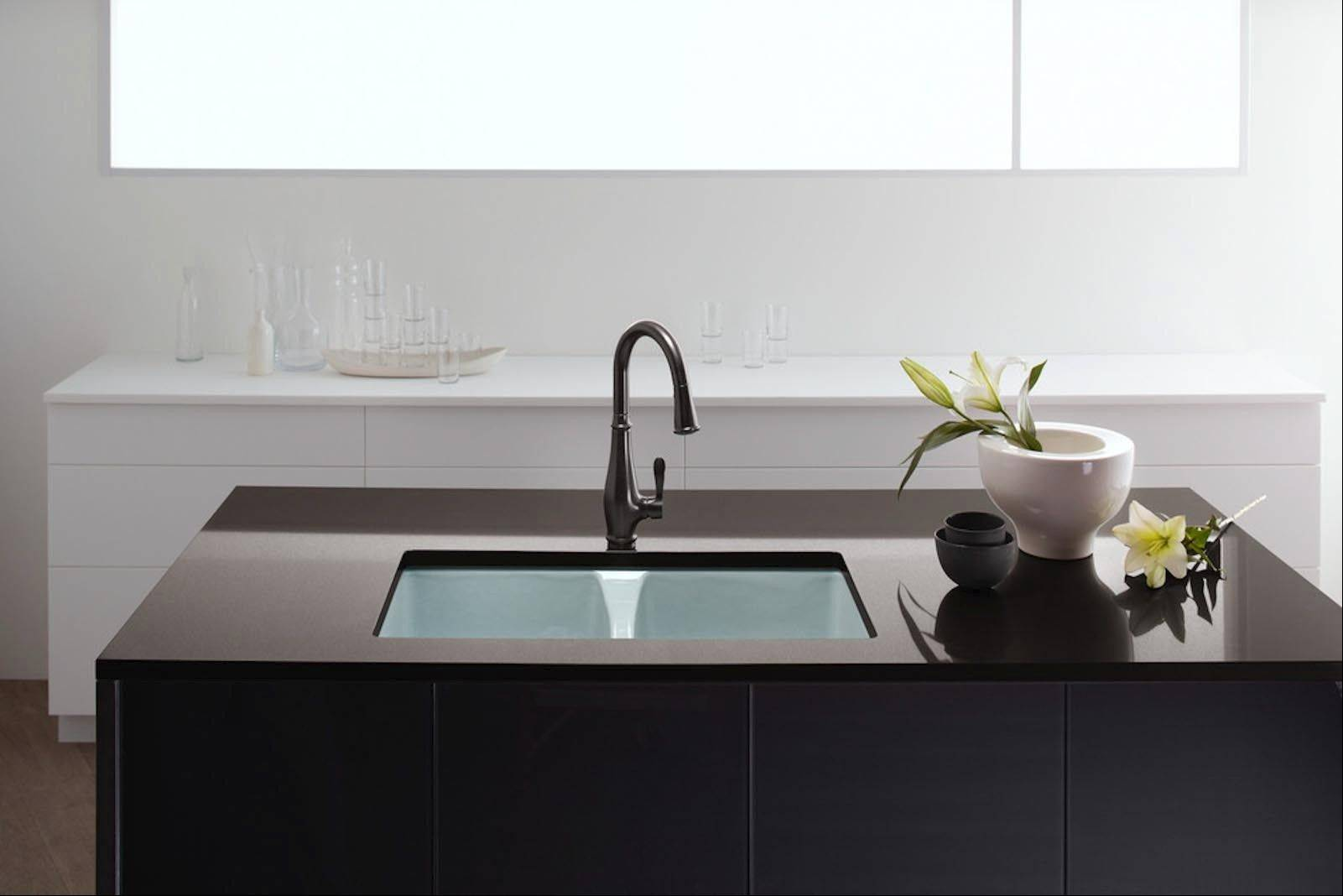 Installing a new sink in your existing kitchen island can be a little complicated and could involve a few contractors.