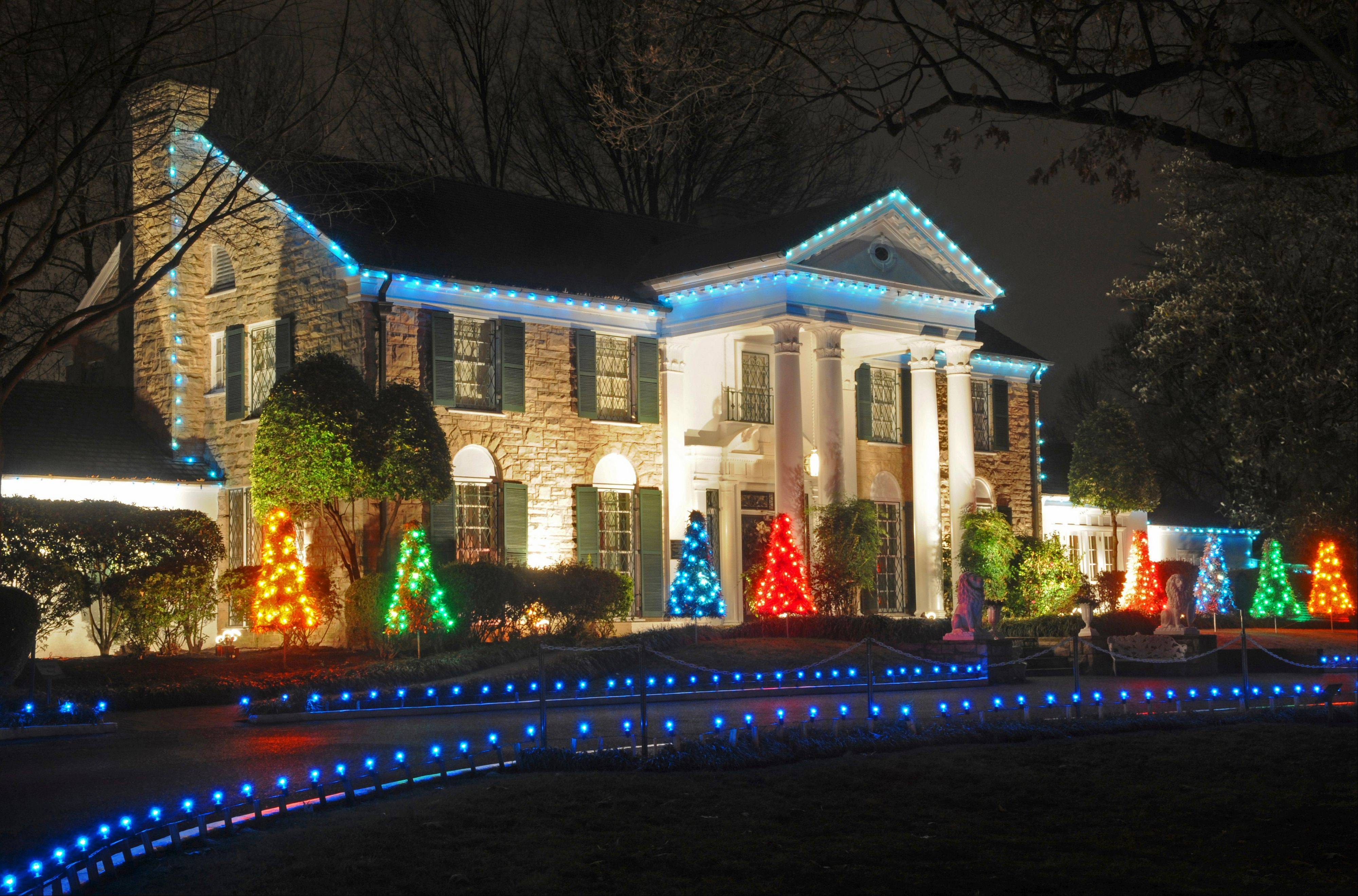 It's a blue Christmas at Elvis Presley's Memphis home, Graceland, as blue lights line the driveway.