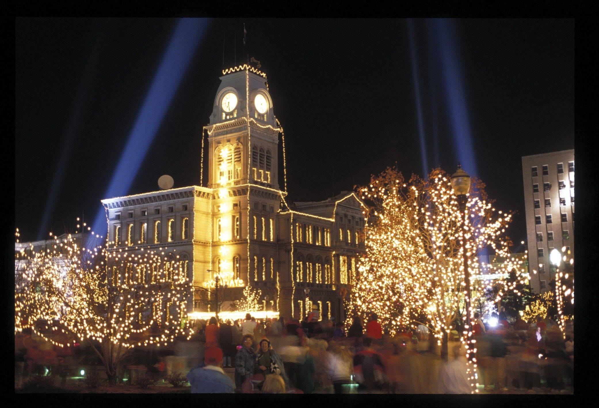 Downtown Louisville, Ky., brightens the evening sky during Light-Up Louisville on the night after Thanksgiving.