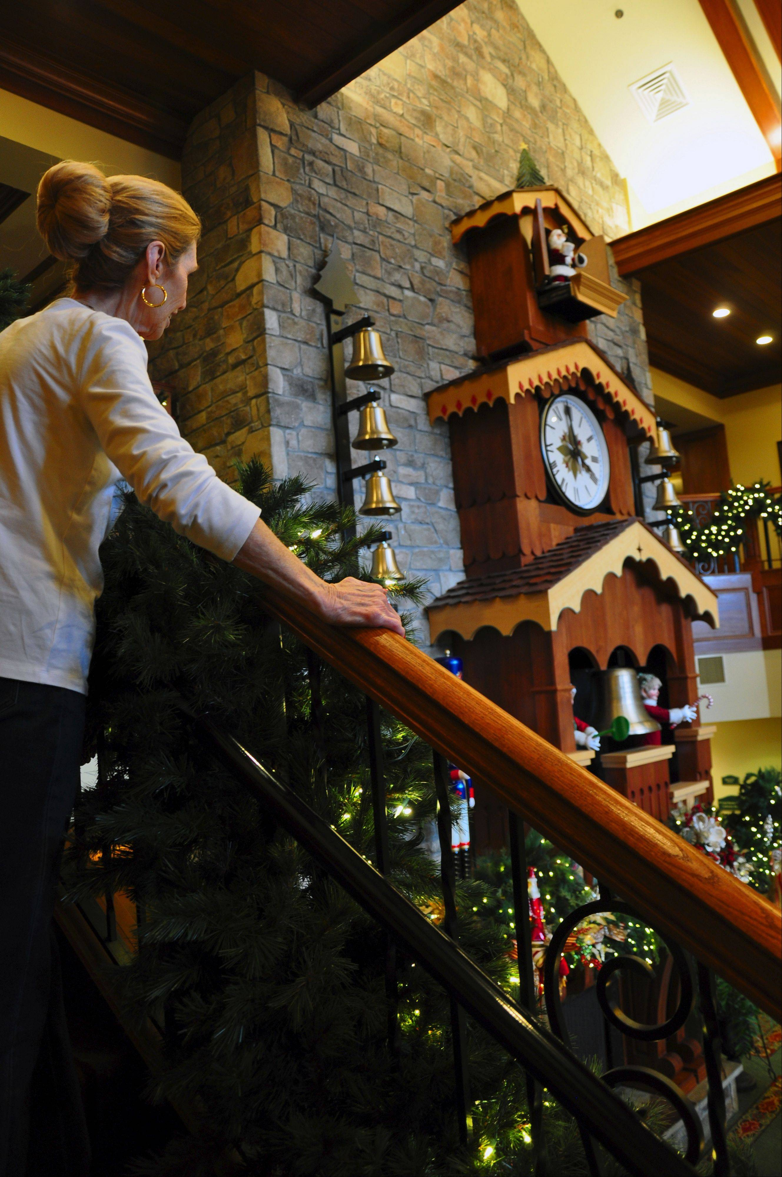 Guests gather around the two-story glockenspiel that plays Christmas carols at the Inn at Christmas Place in Pigeon Forge, Tenn.