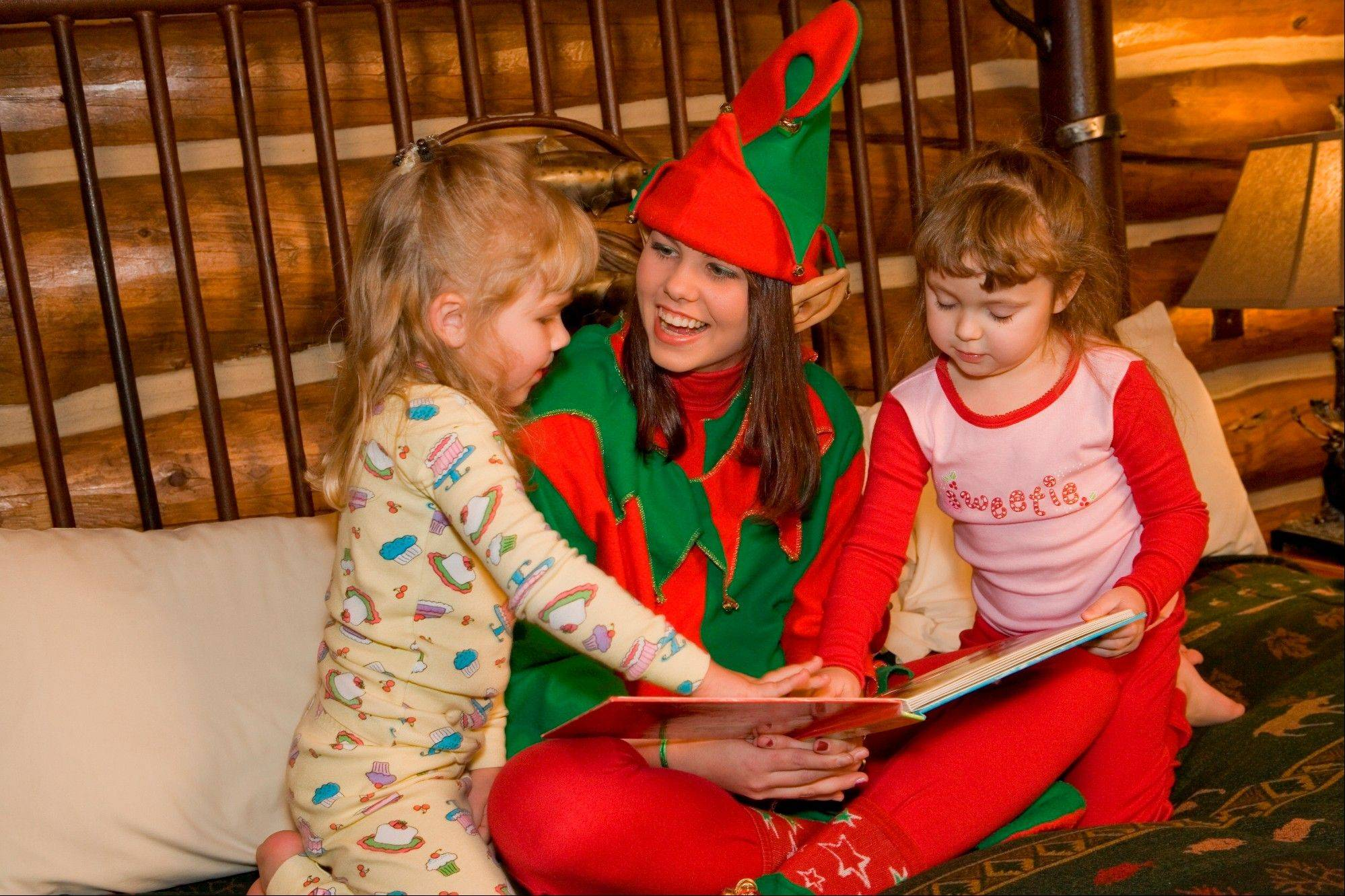 The Christmas Elf reads bedtime stories to children at Big Cedar Lodge near Branson, Mo.