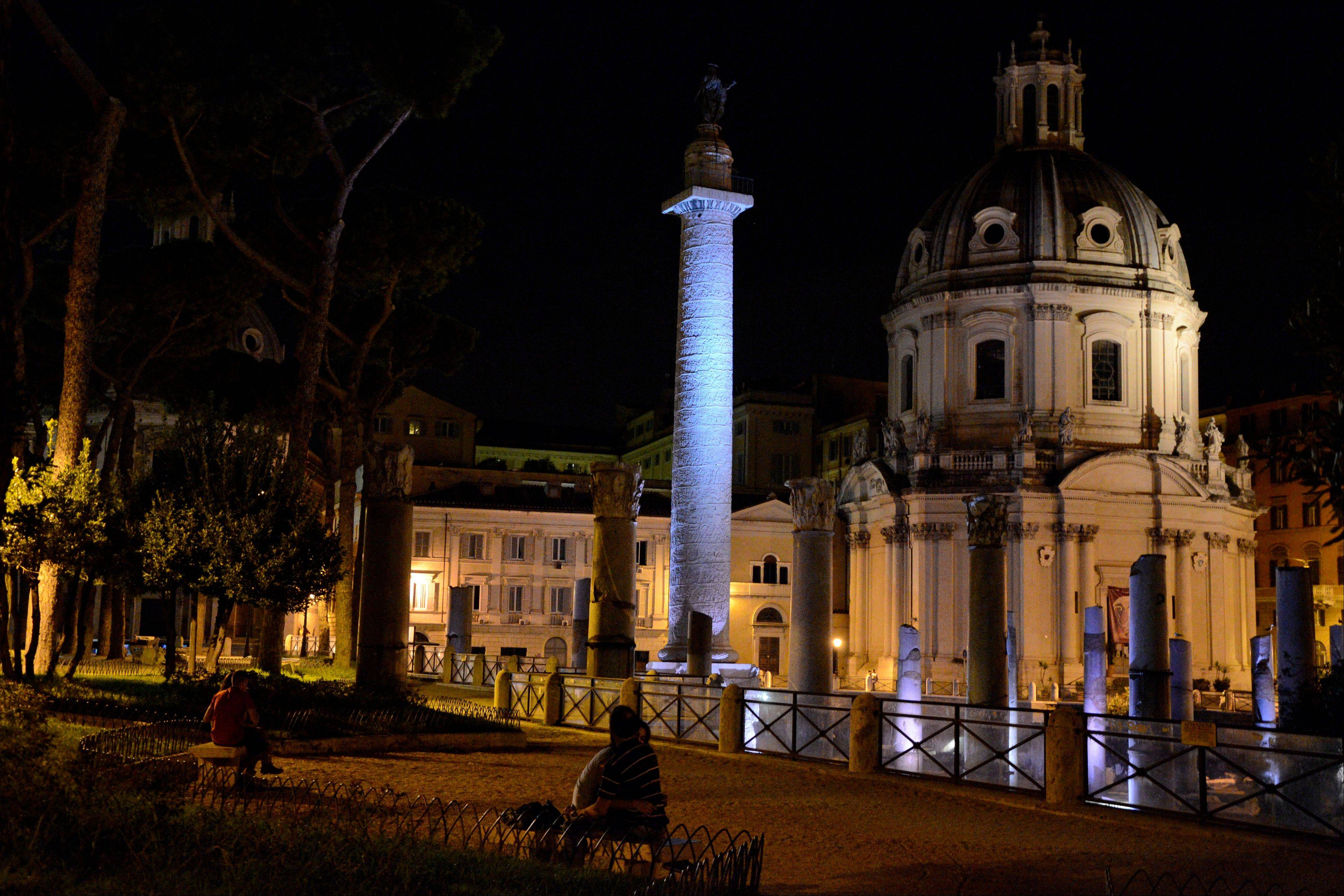The Roman Forums by night are transformed into a romantic spot with white, blue and green beams of light coloring the ruins. The Way of the Imperial Forums, the street leading from Piazza Venezia to the Colosseum, is among the best-known places in Rome.
