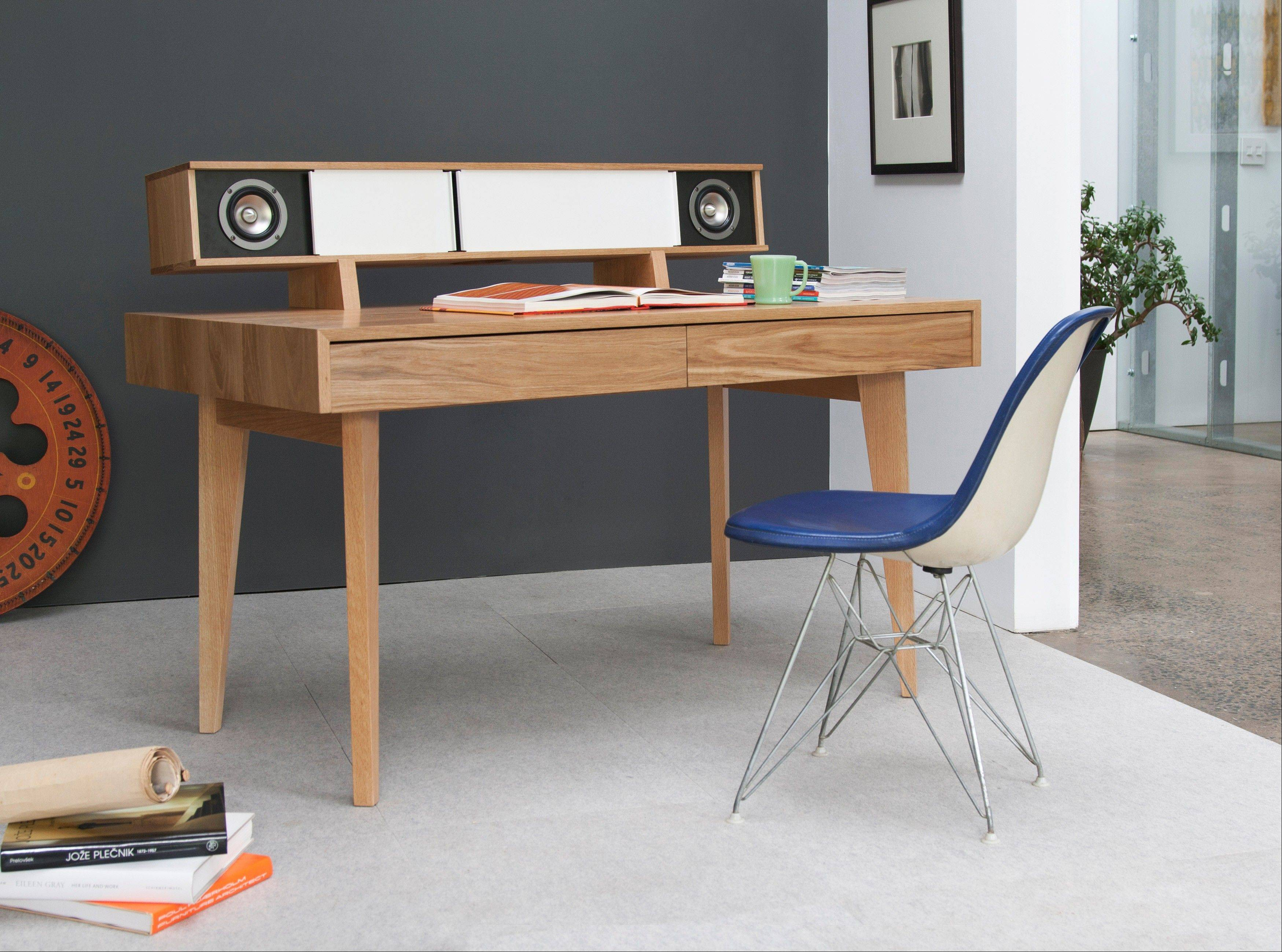 The integration of technology into home decor has come a long way. Symbol's Audio Desk with high quality speakers built into a sleek desk, available in maple, walnut, oak or cherry.
