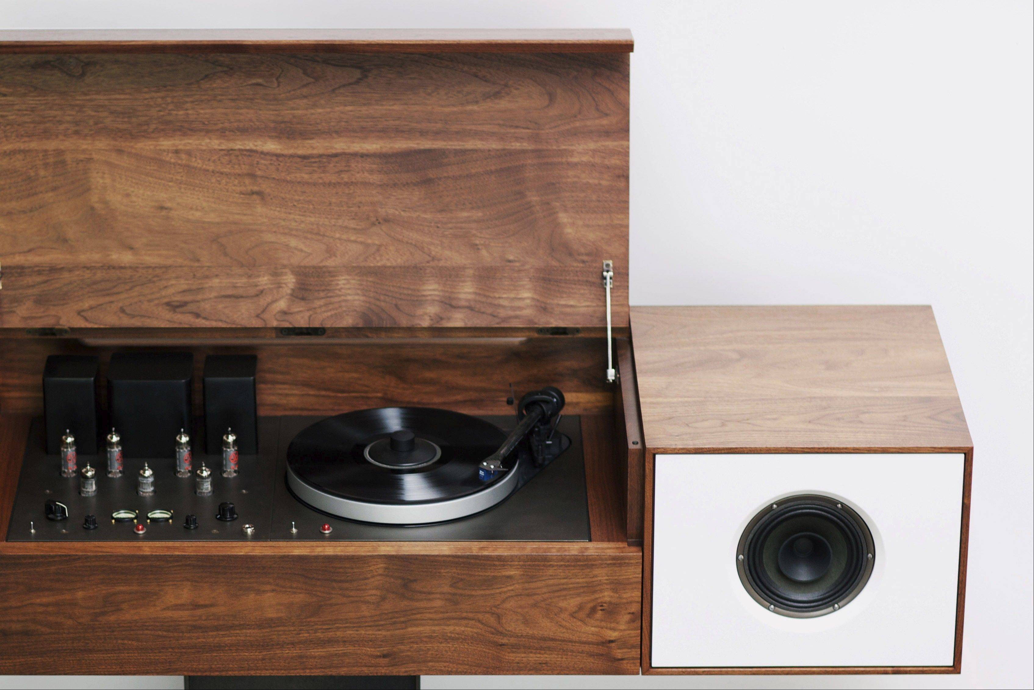 A new version of the retro hi-fi system, Symbol Audio's Modern Record Console, has a walnut cabinet outfitted with a hand-built turntable, amplifier and built in wireless router.