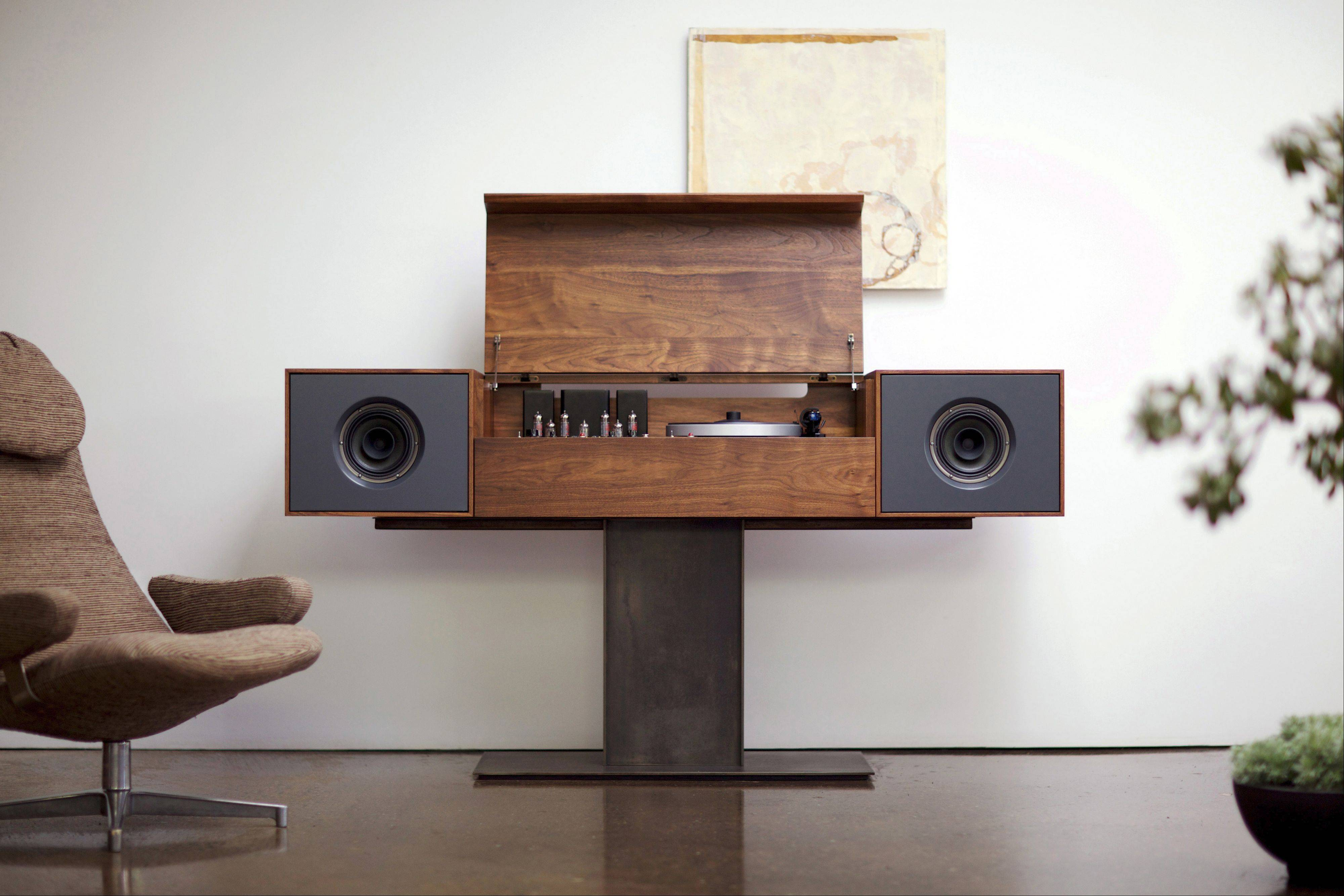 Symbol Audio's Modern Record Console has a walnut cabinet with a record turntable, amplifier and built in wireless router.