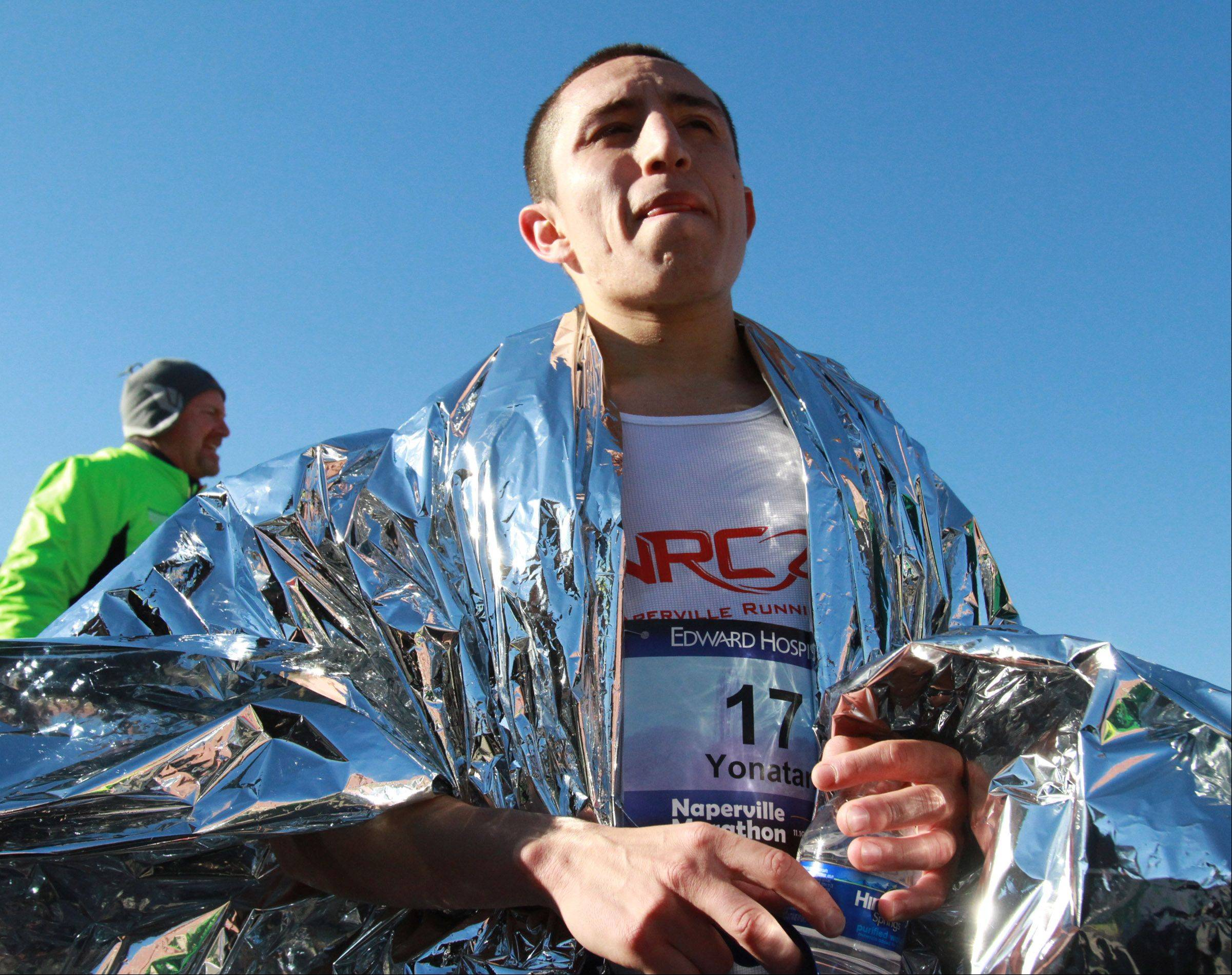 Yonatan Mascote of Naperville won the city's inaugural marathon Sunday with a time of 2:34:25.