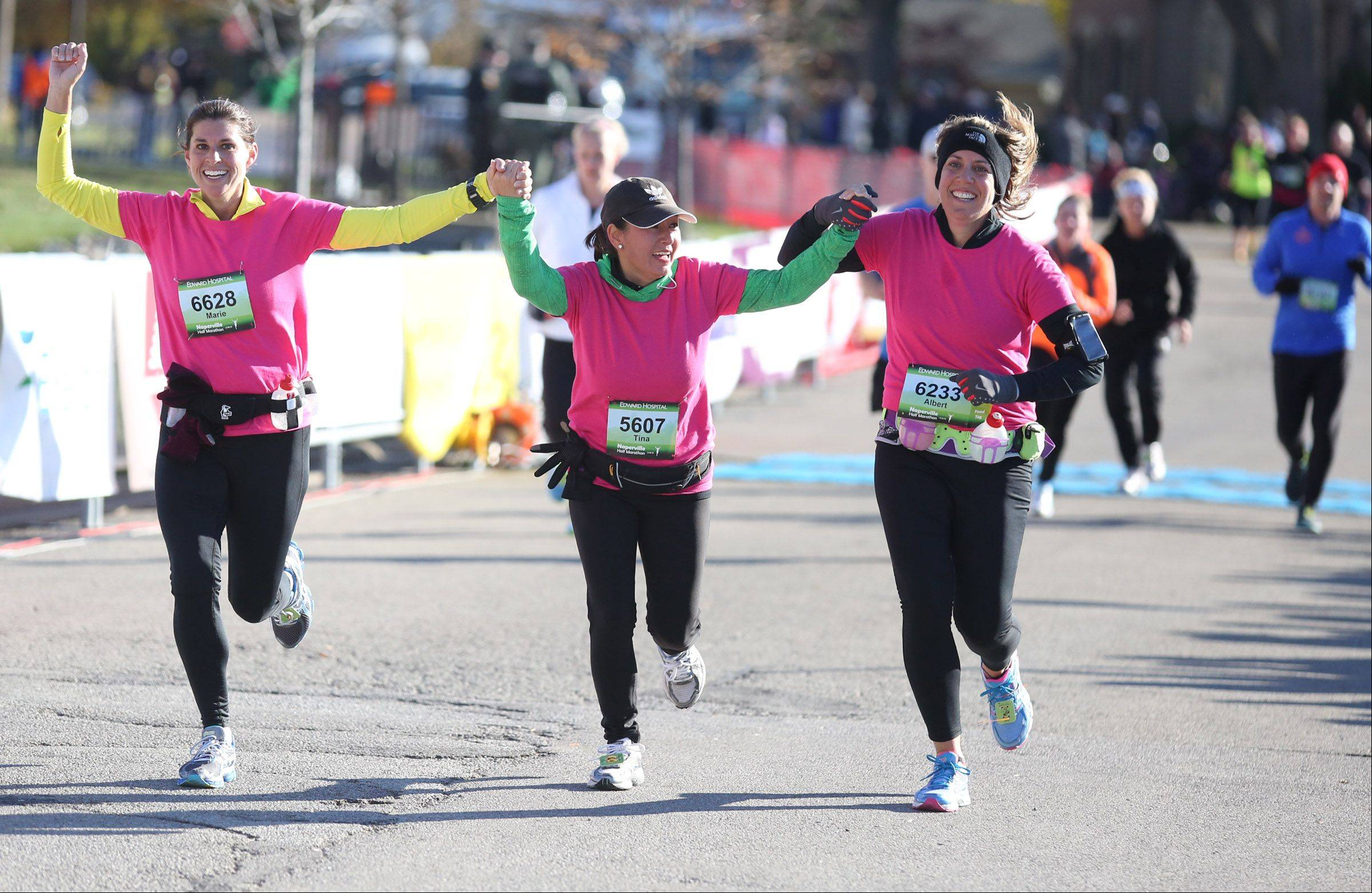 Runners about to cross the finish line in Sunday's half marathon in Naperville.