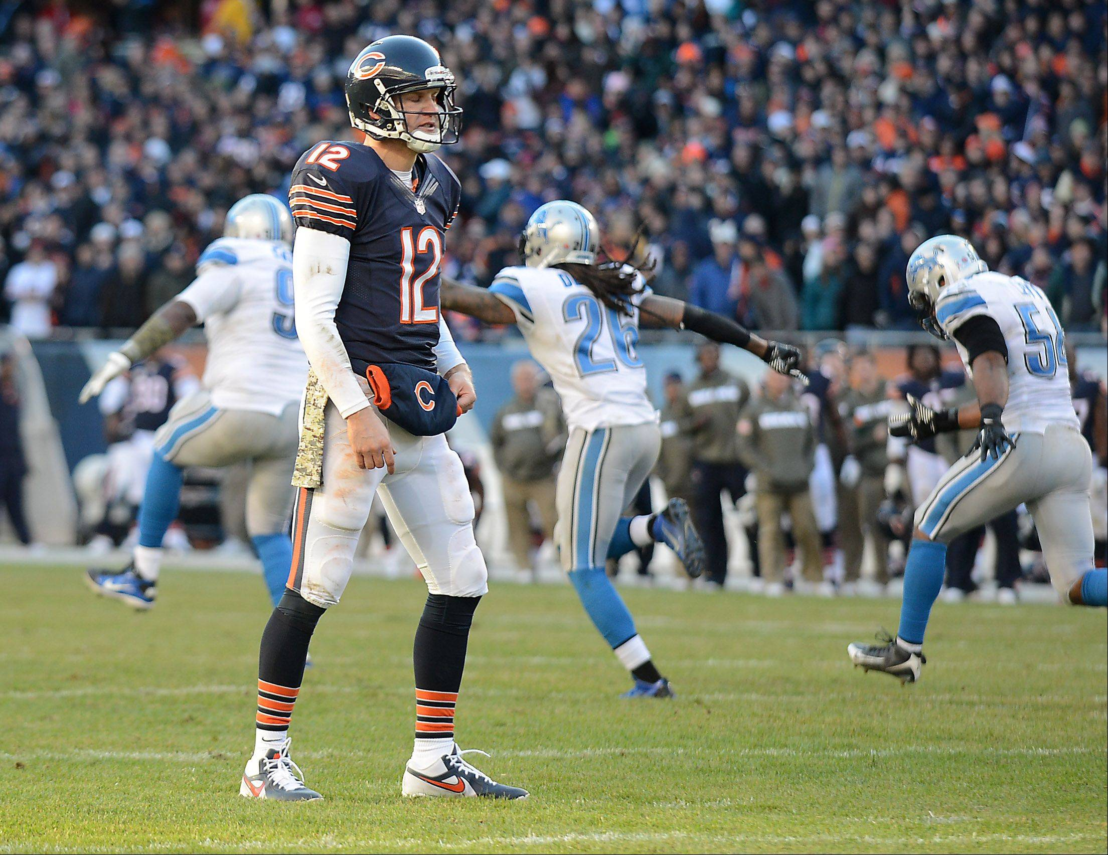 Chicago Bears quarterback Josh McCown (12) and the Detroit Lions defense react after the Bears failed on a two-point conversion attempt in the final minute during Sunday's game in Chicago.