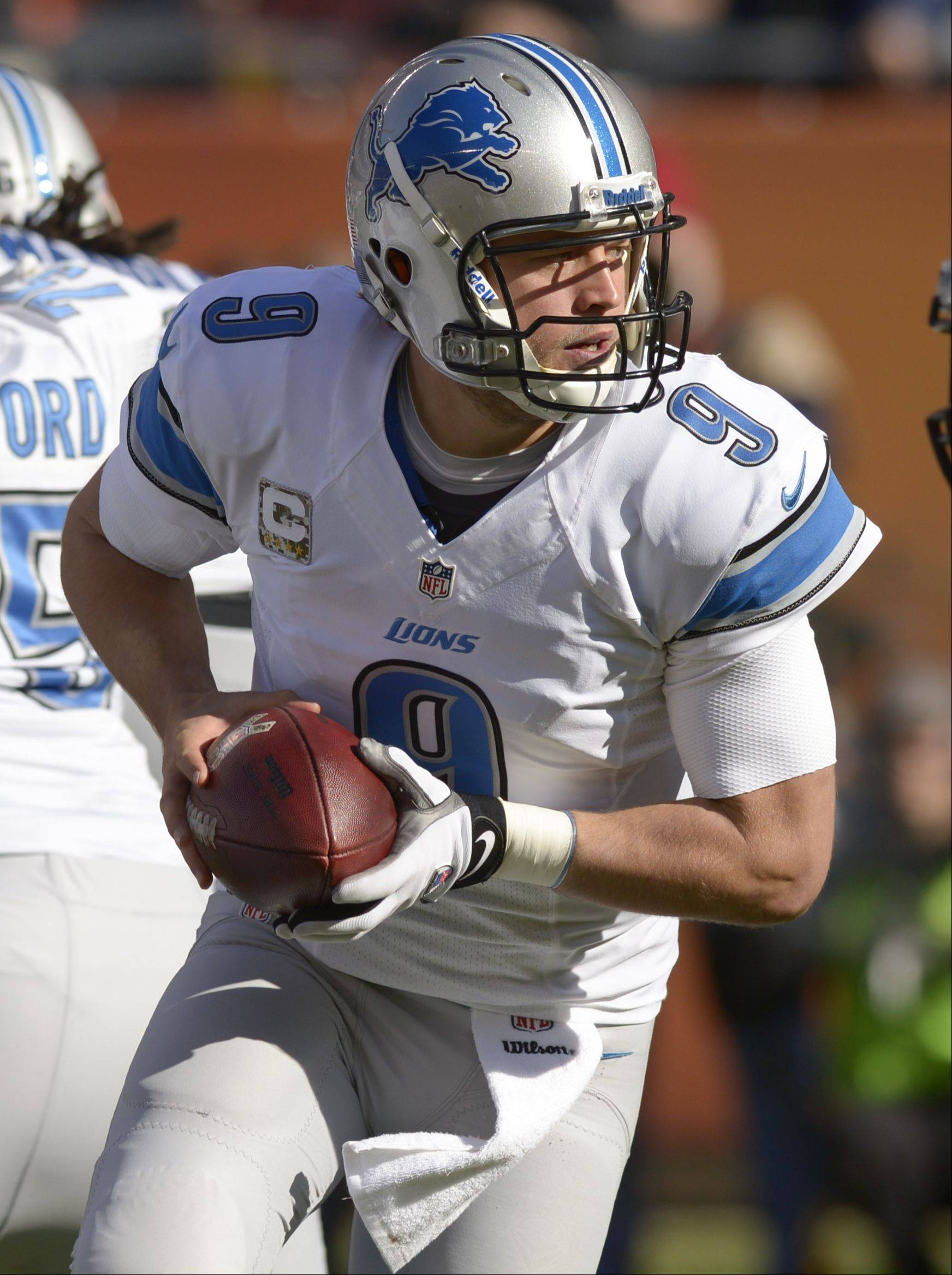 Detroit Lions quarterback Matthew Stafford scrambles against the Chicago Bears at Soldier Field, Sunday.