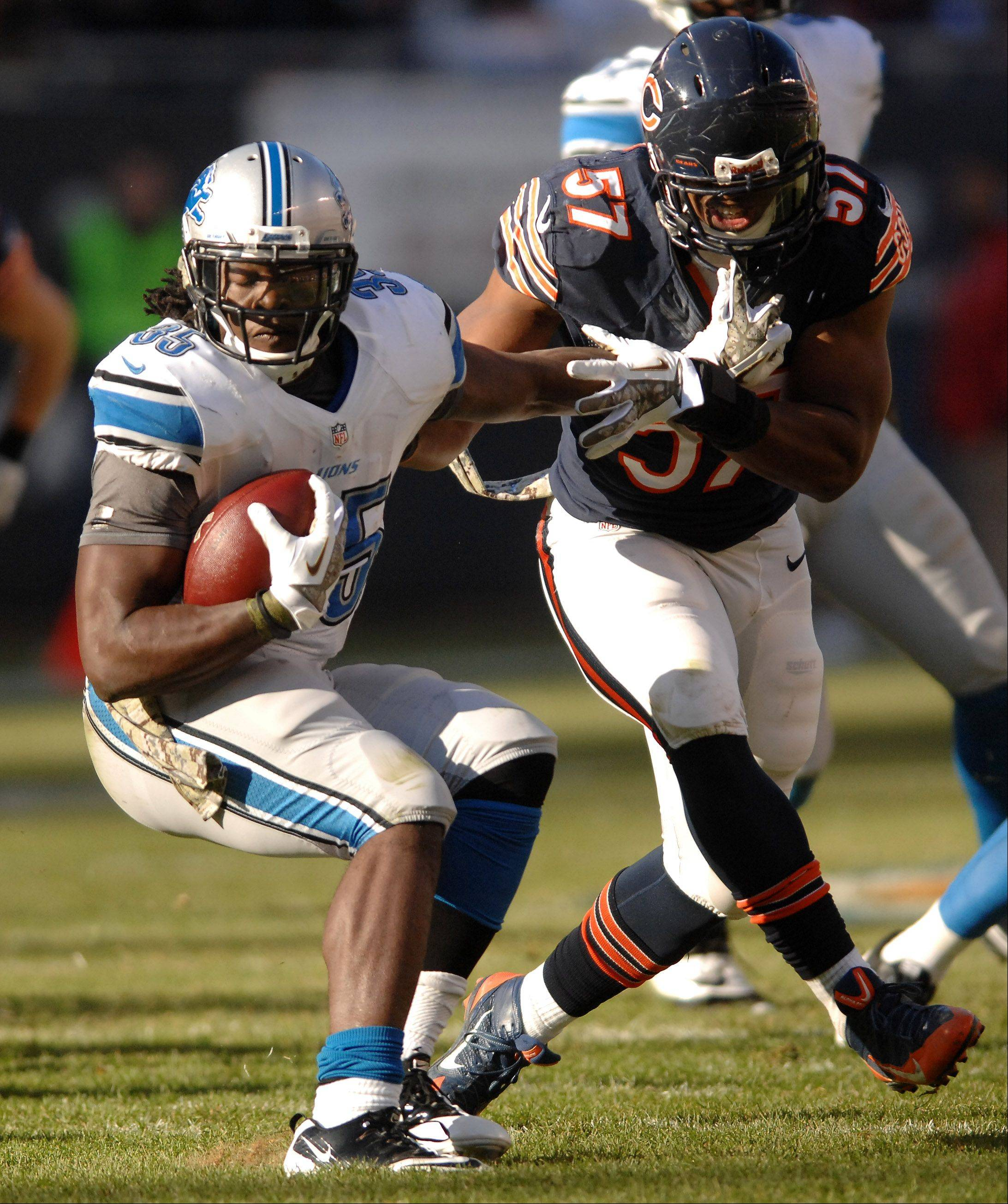 Detroit Lions running back Joique Bell (35) spins away from Chicago Bears inside linebacker Jon Bostic (57) during Sunday's game in Chicago.