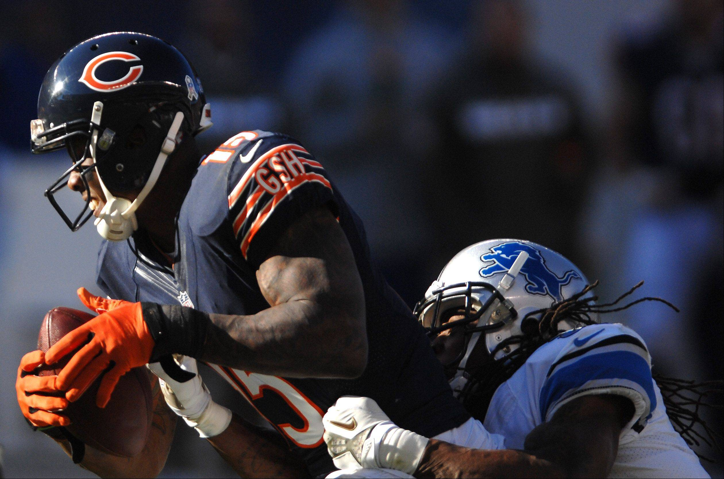 Chicago Bears wide receiver Brandon Marshall (15) drags Detroit Lions cornerback Rashean Mathis (31) for some extra yardage during the third quarter of Sunday's game in Chicago.
