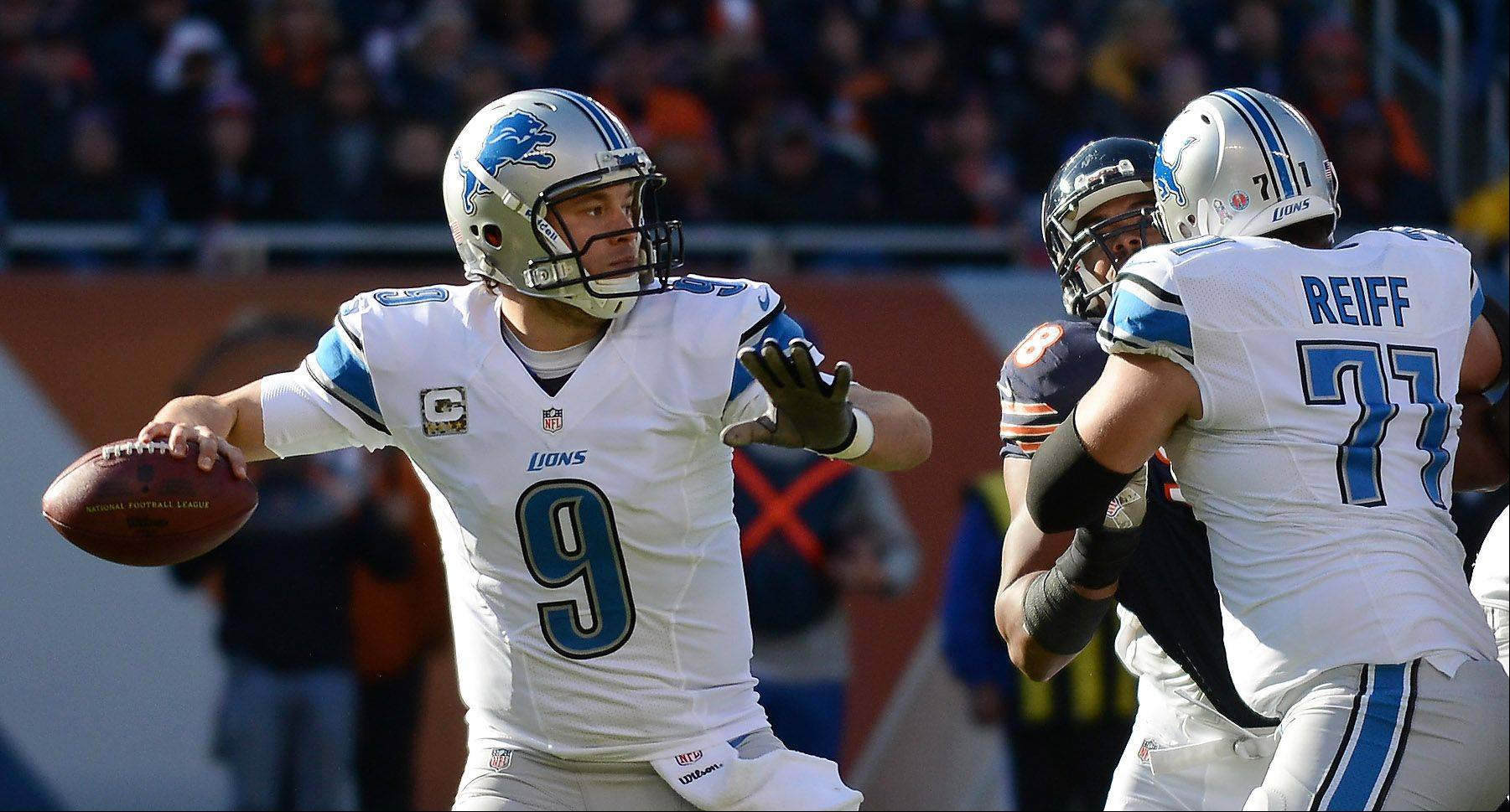Detroit Lions quarterback Matthew Stafford (9) fires a pass during Sunday's game in Chicago.