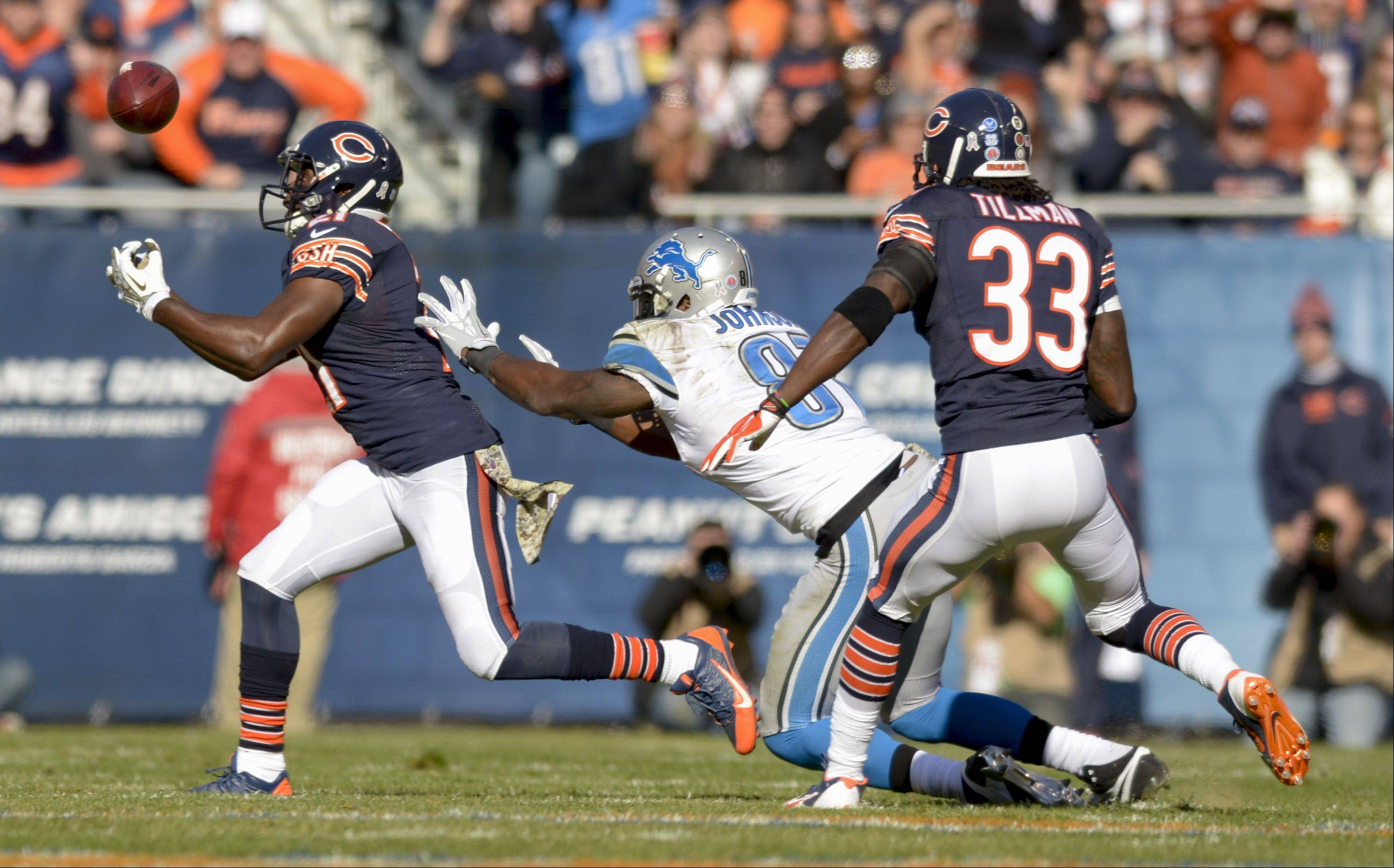 Chicago Bears strong safety Major Wright just can't get a hold of the ball during the Bears 21-19 loss to the Detroit Lions at Soldier Field, Sunday.