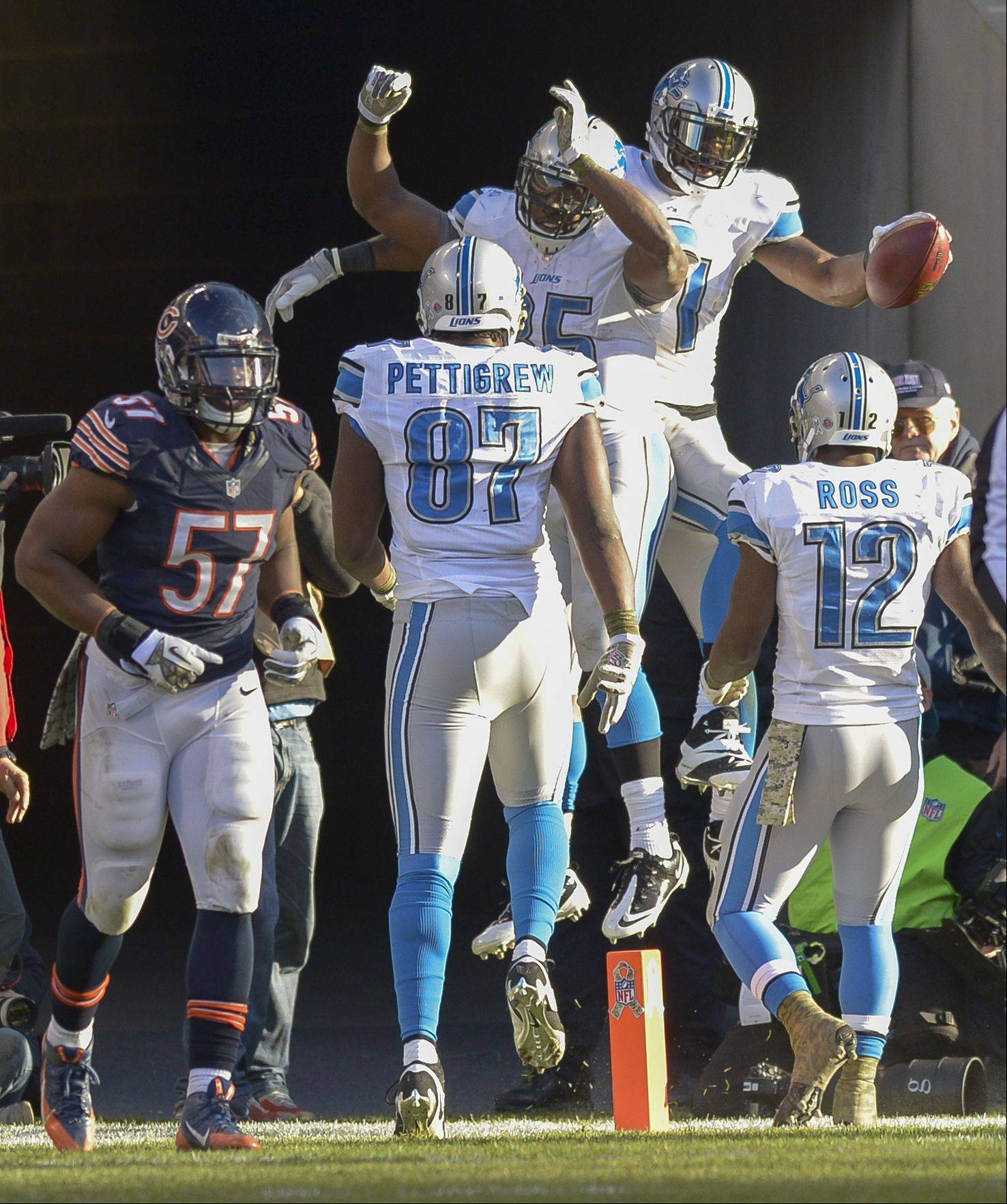The Detroit Lions celebrate a 4th quarter touchdown against the Chicago Bears Sunday in Chicago.