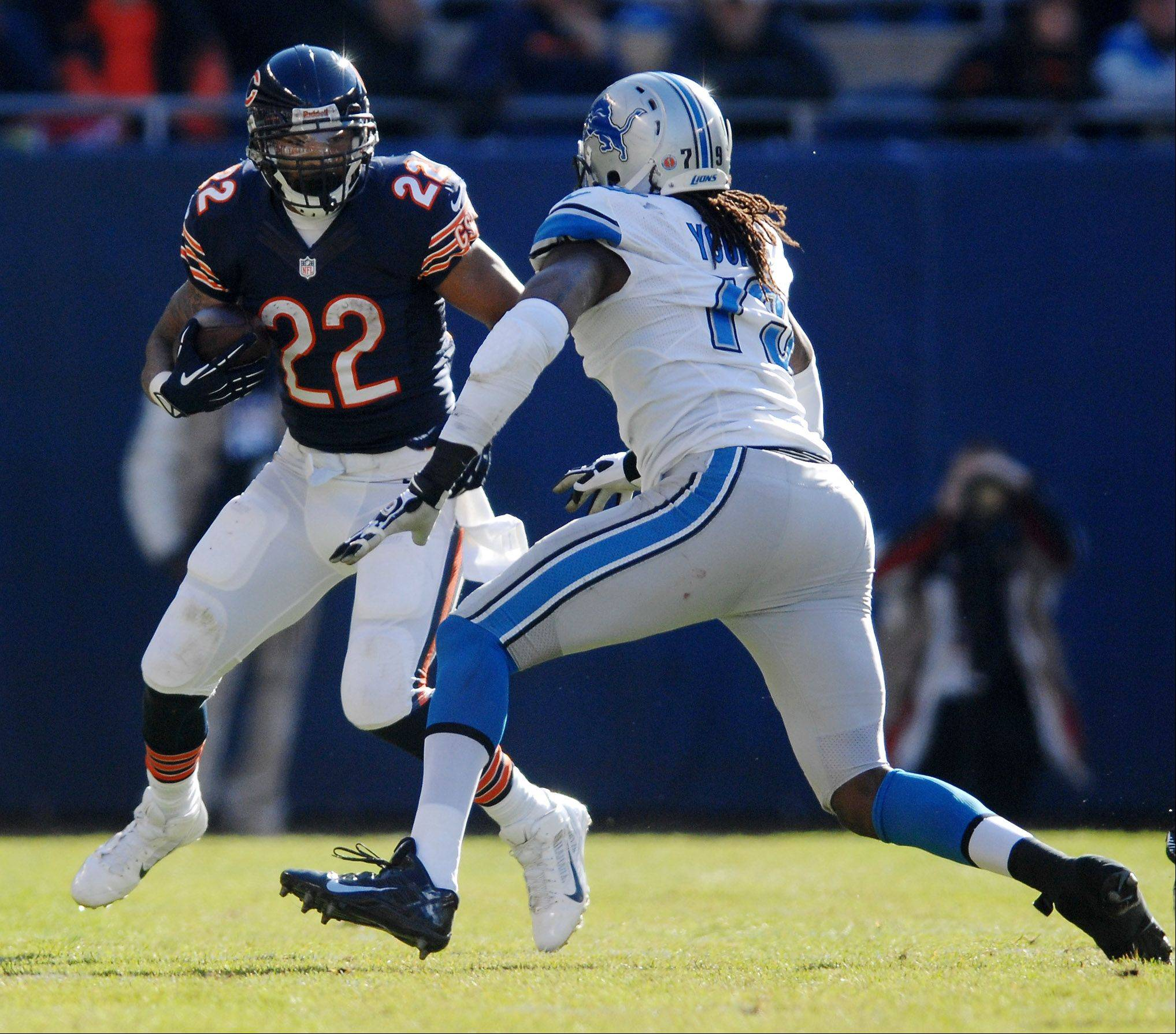 Chicago Bears running back Matt Forte (22) cant's find room to run as he's bottled up by Detroit Lions defensive end Willie Young (79) during Sunday's game in Chicago.