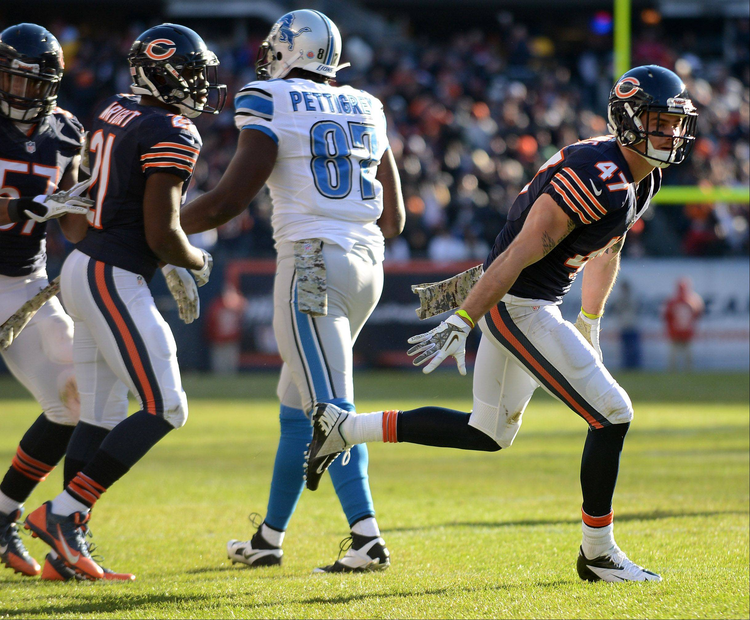 Chicago Bears free safety Chris Conte (47) celebrates his fourth quarter interception during Sunday's game in Chicago.