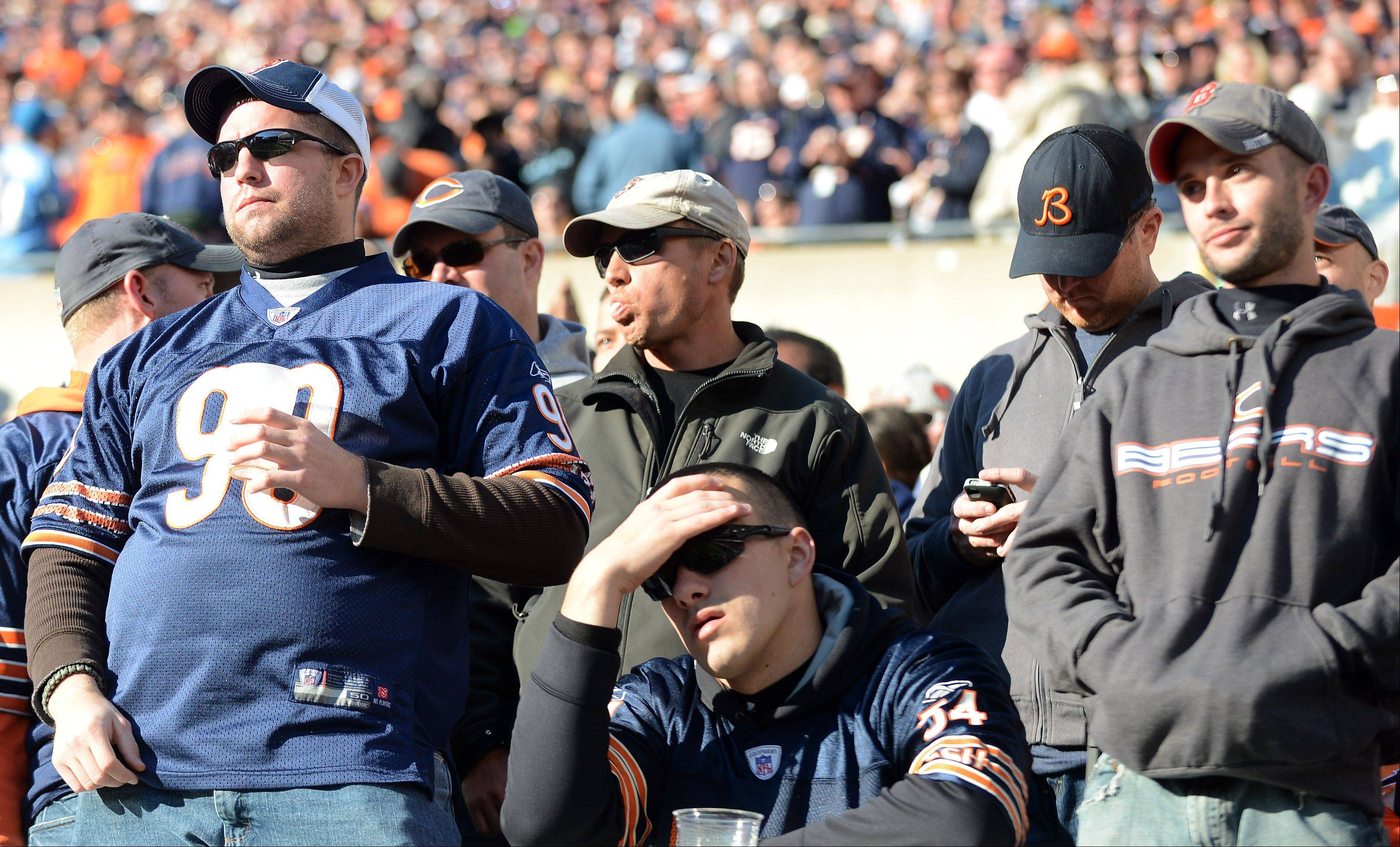Bears fans react as things start to look grim in the fourth quarter during Sunday's game in Chicago.
