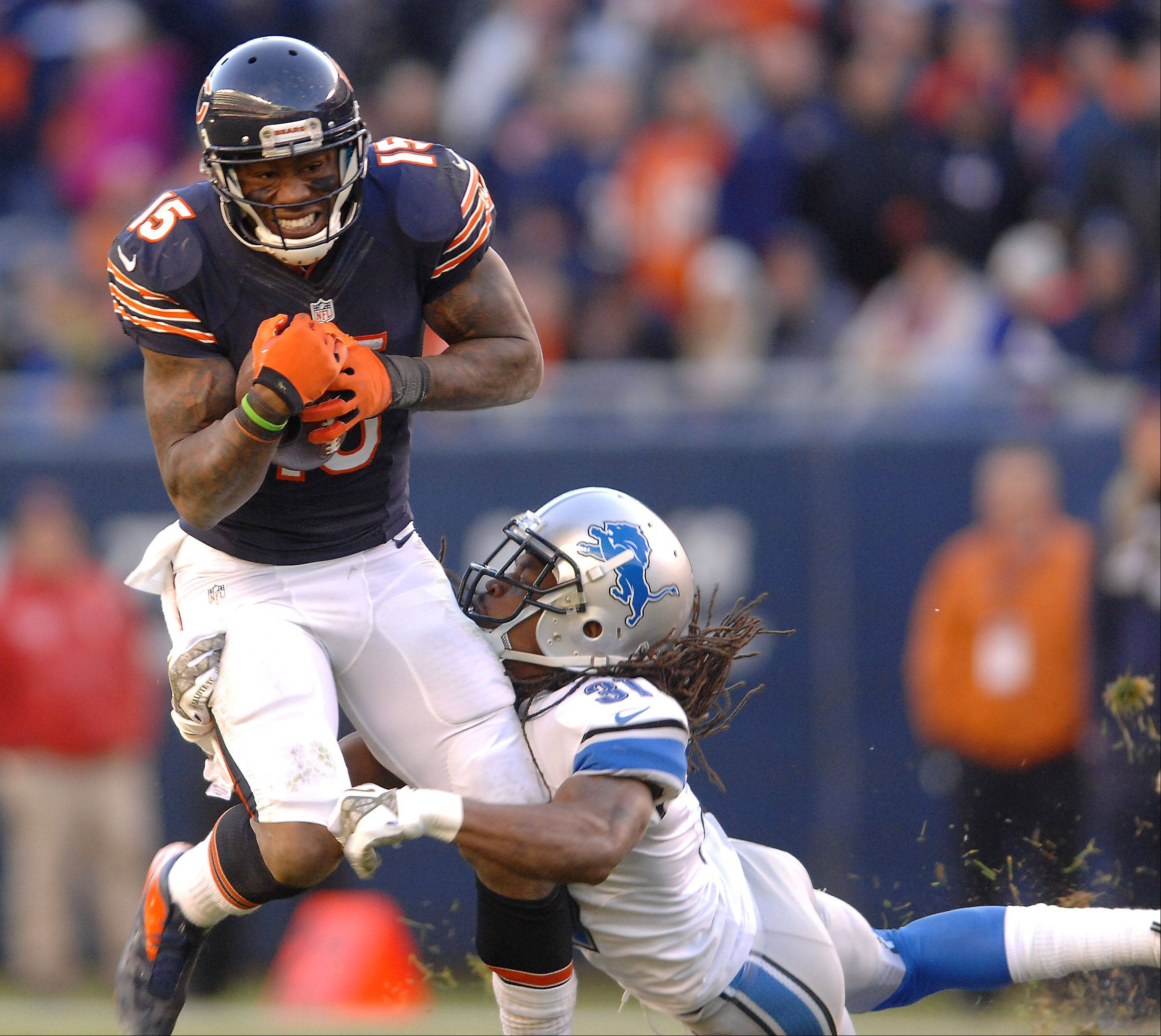 Chicago Bears wide receiver Brandon Marshall (15) tries to shake Detroit Lions cornerback Rashean Mathis (31) after a reception on the Bears final drive during Sunday's game in Chicago.