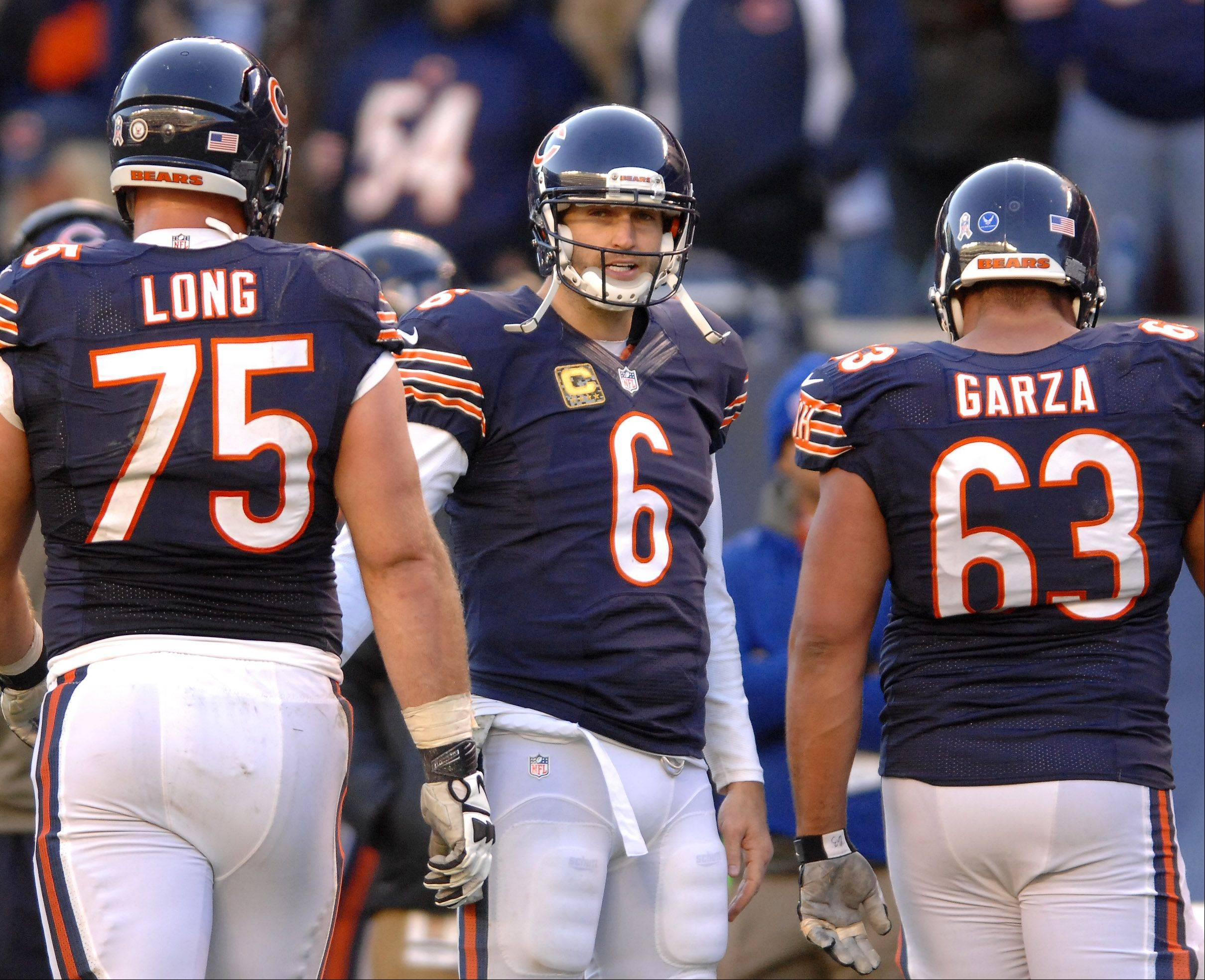 Injured Chicago Bears quarterback Jay Cutler (6) stands on the sidelines and watches his teammates come off the field after a failed two-point conversion dashed the Bears hopes for a comeback against Detroit during Sunday's game in Chicago.