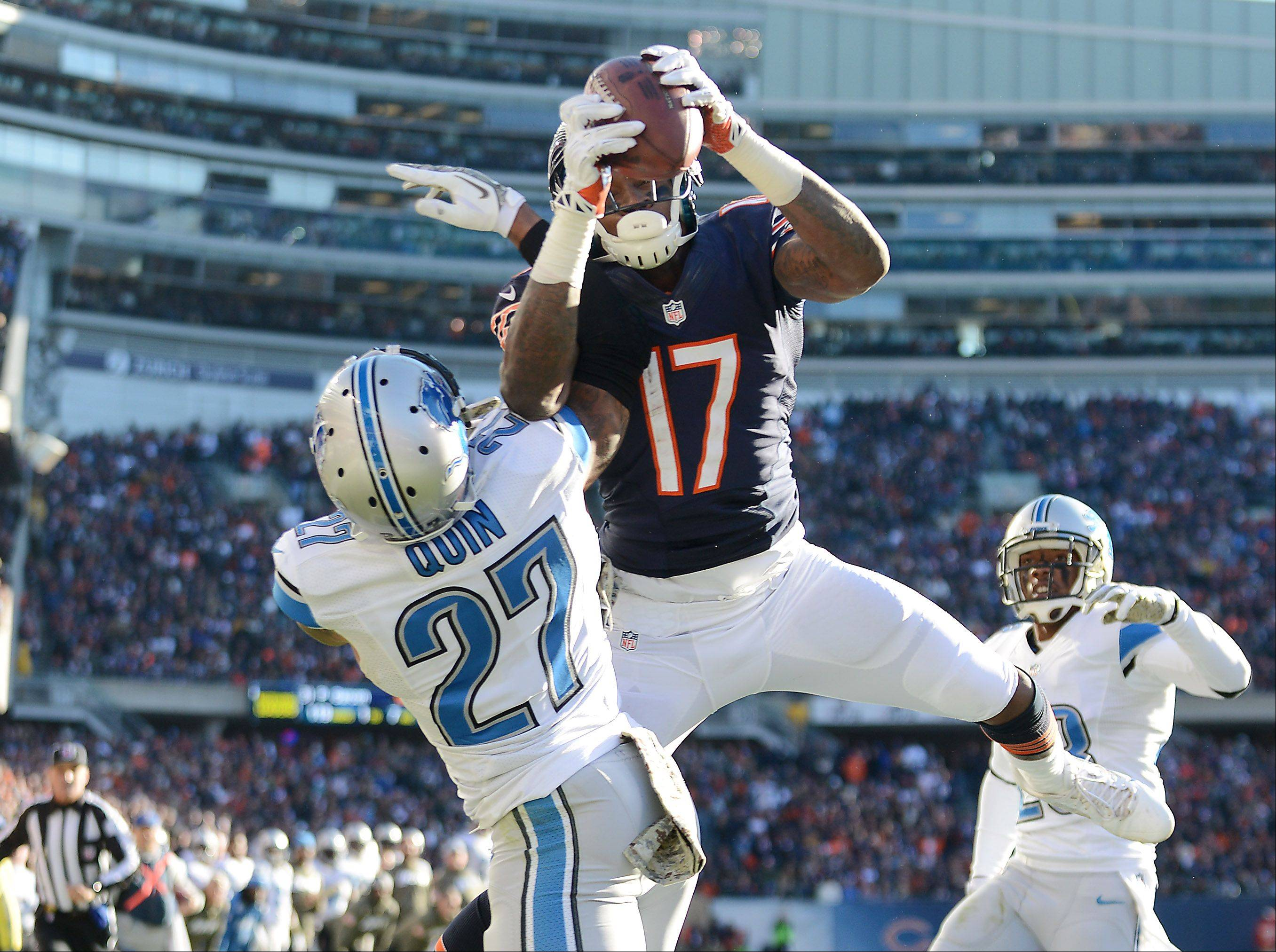 Chicago Bears wide receiver Alshon Jeffery (17) comes up with an apparent touchdown catch while battling Detroit Lions strong safety Glover Quin (27) during the fourth quarter of Sunday's game in Chicago. The play was overturned on review.