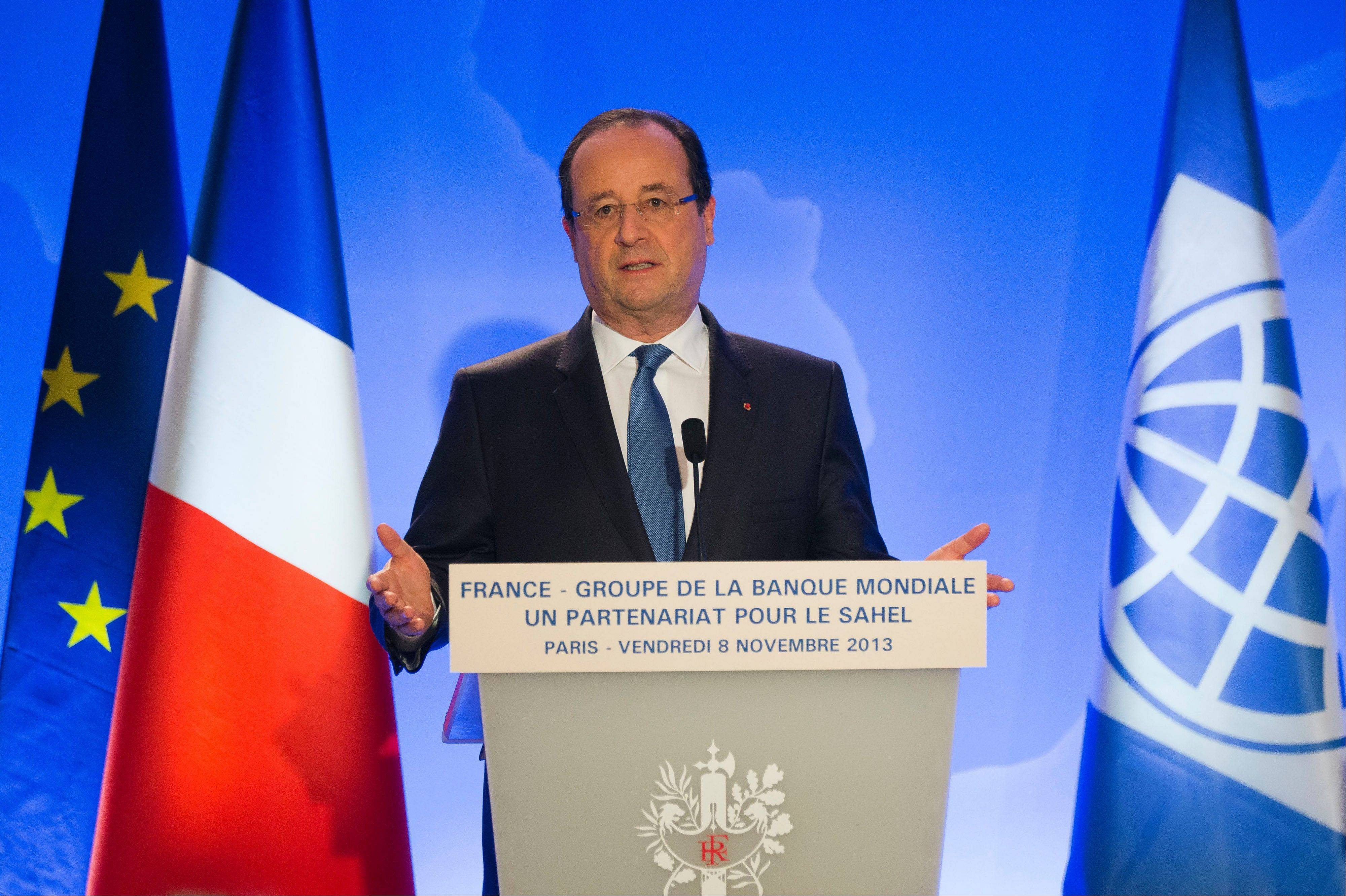 French President Francois Hollande, gestures as he speaks to the media during a press conference at the World Bank Paris Office in Paris Friday. When Iran appeared close to a preliminary deal with world powers over its nuclear program this weekend, France stepped up to say not so fast.