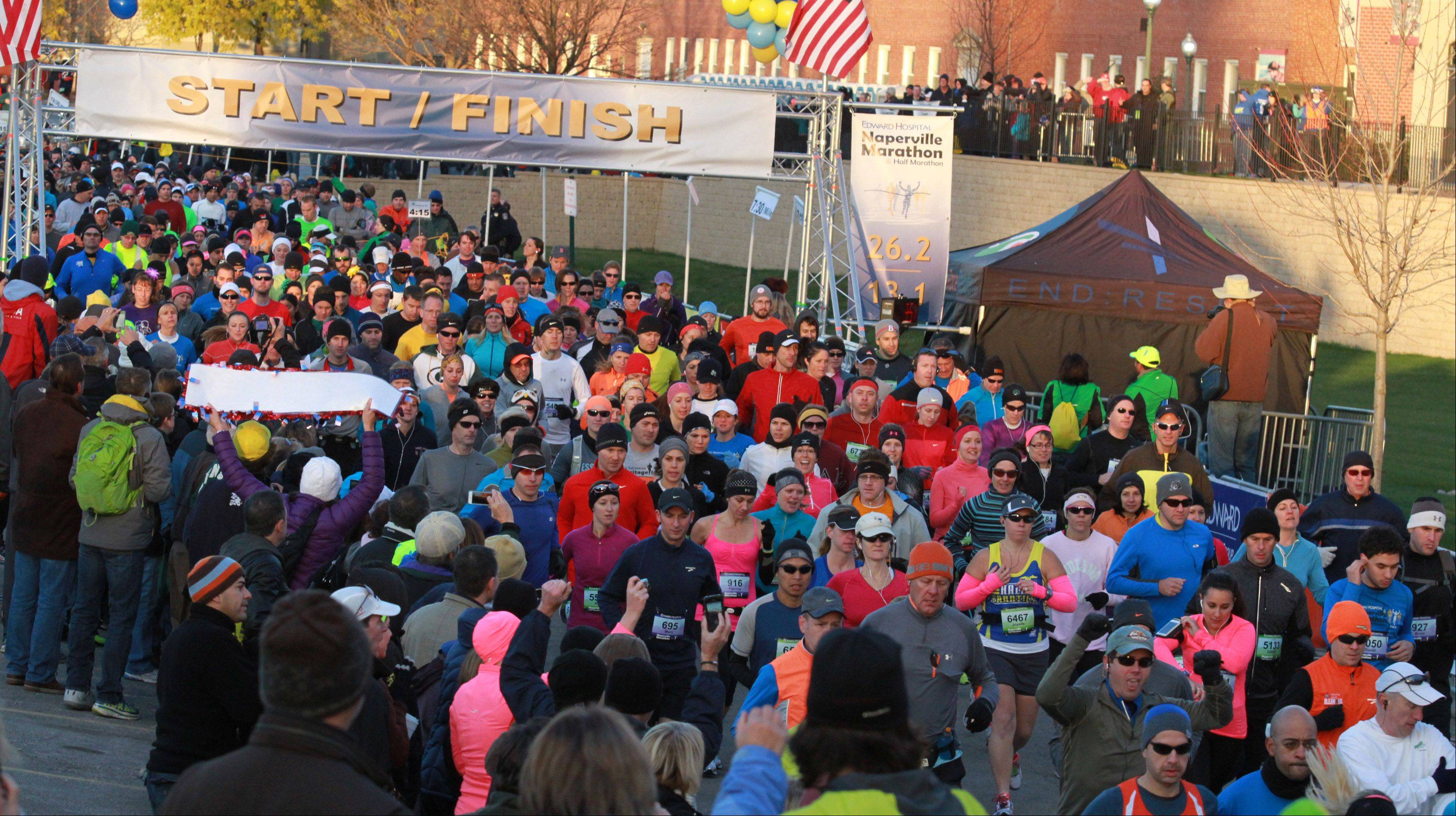 Runners at the start of the inaugural Edward Hospital Naperville Marathon and Half Marathon on Sunday, November 10, 2013.