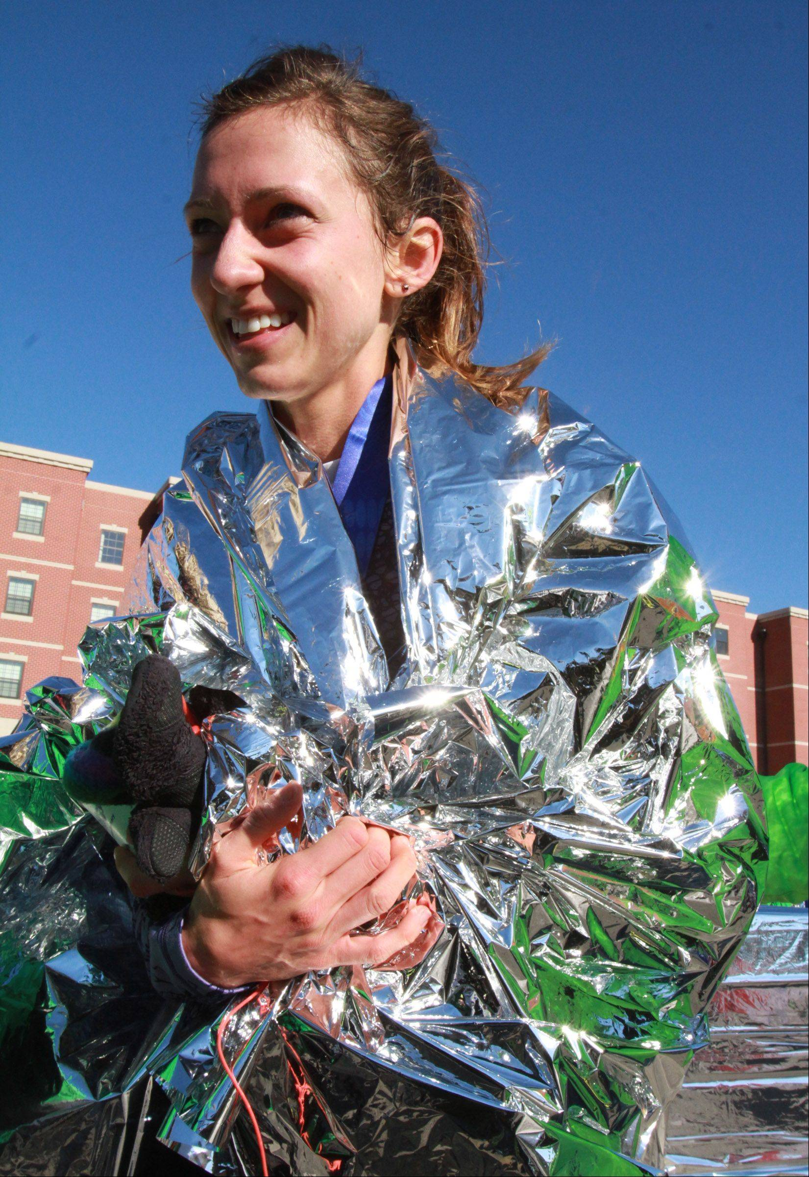 Amanda Mirochna of Naperville was the first women to cross the finish line in the Edward Hospital Naperville Marathon on Sunday, November 10, 2013.