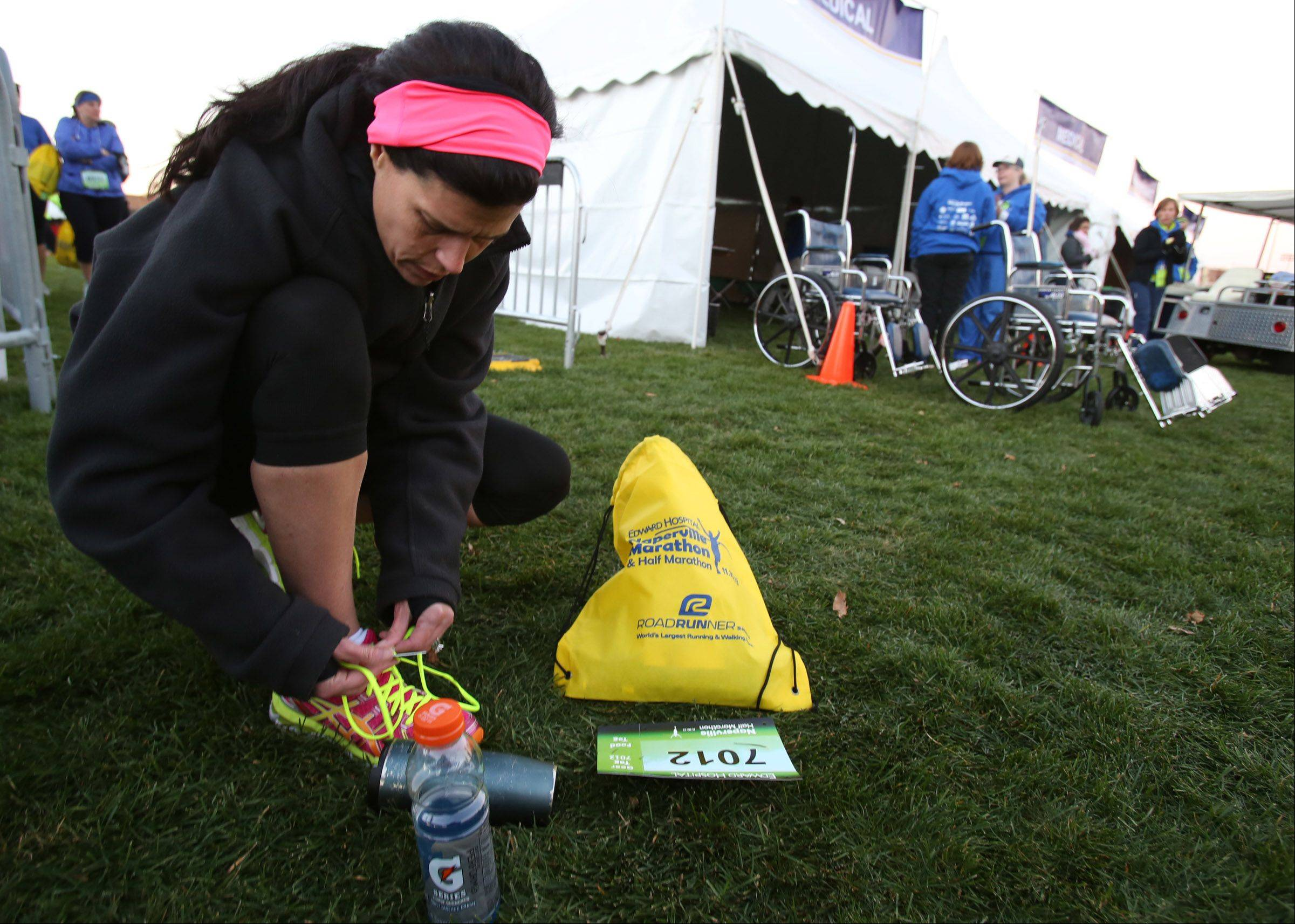 Louise Bornhofen prepares for the start of the Edward Hospital Naperville Marathon on Sunday, November 10, 2013.