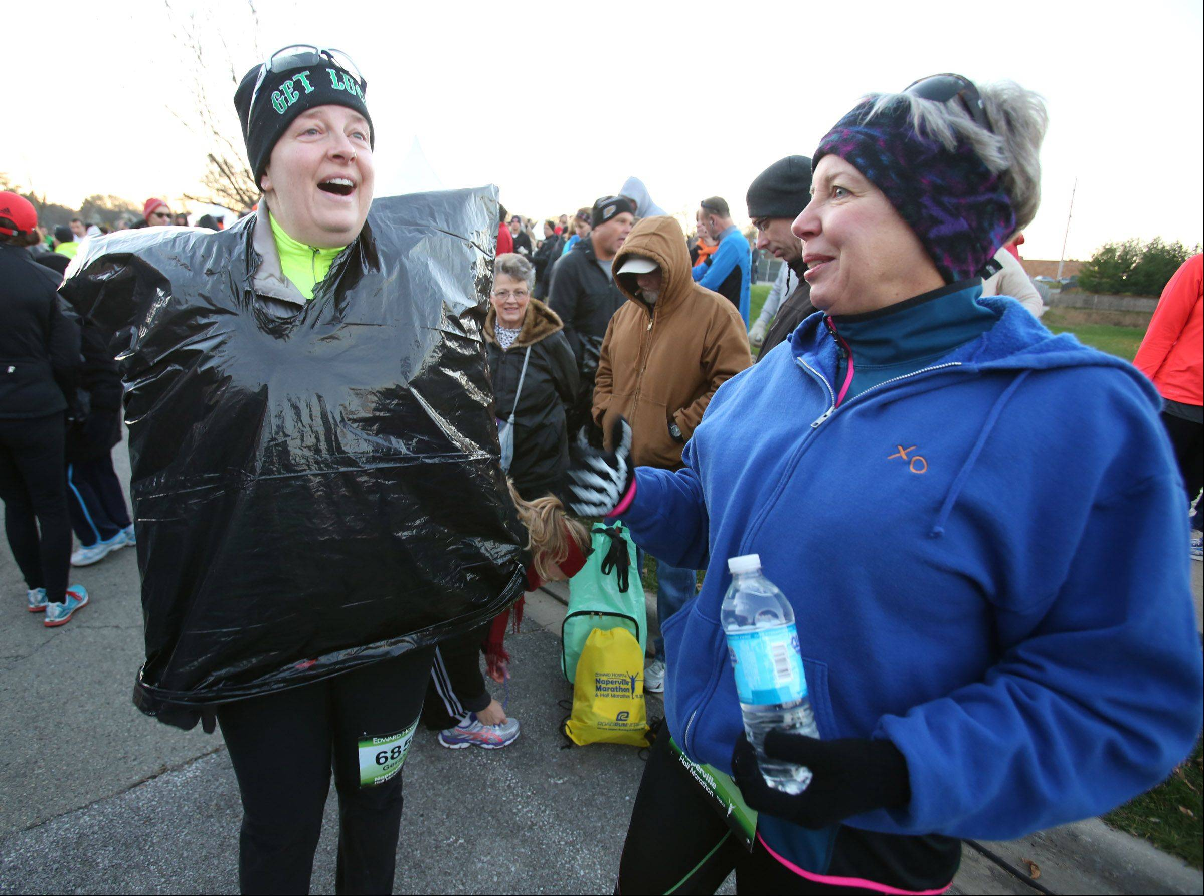 Lynn Walsh of Hinsdale, left, and Kristin Shulmar of Naperville talks about how nice the weather is just before the start of the Edward Hospital Naperville Marathon Sunday, November 10, 2013.