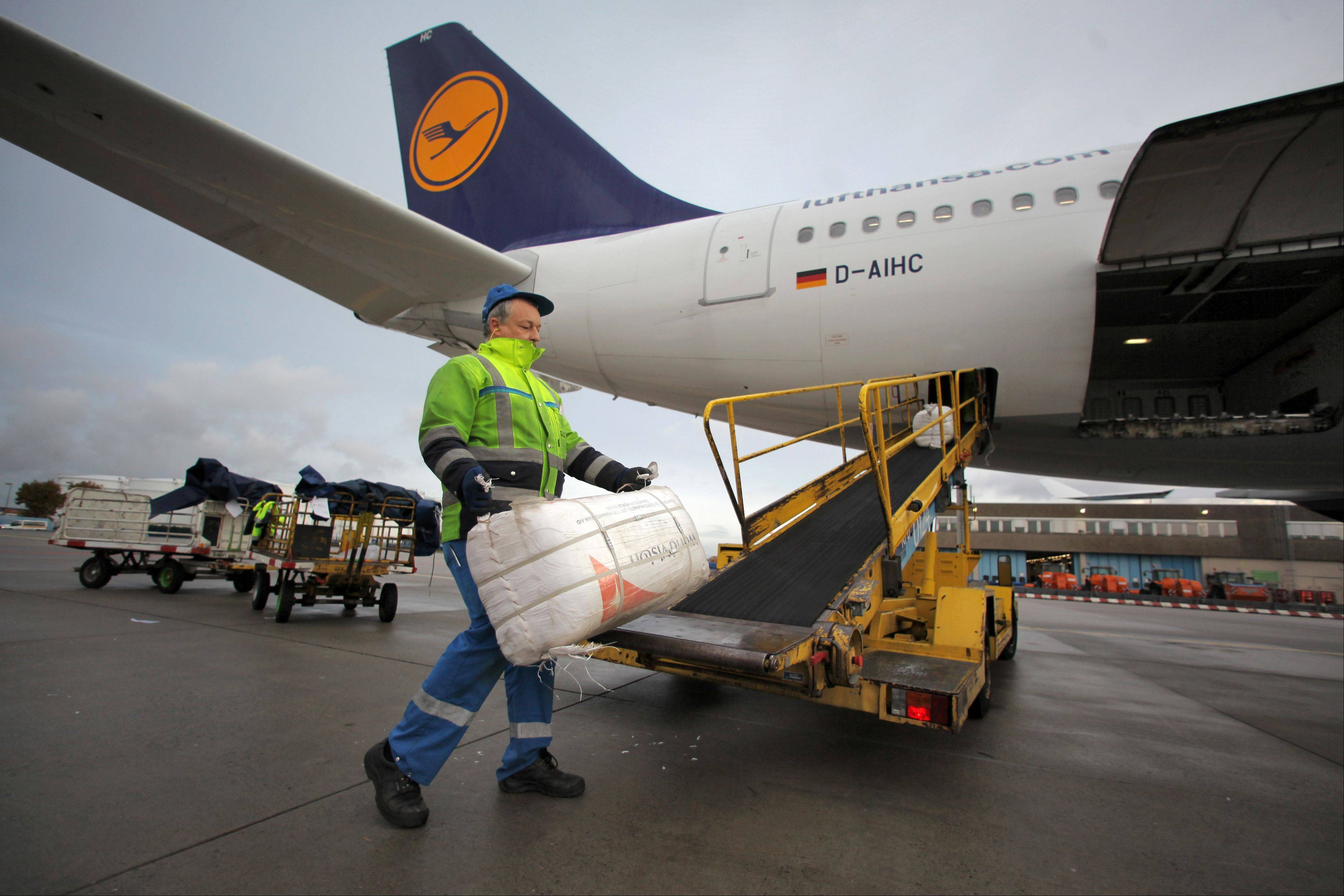 A worker loads humanitarian aid for the Philippines into a Lufthansa plane at Rhein-Main Airport in Frankfurt, central Germany, Sunday. Typhoon Haiyan, one of the strongest storms on record, slammed into six central Philippine islands on Friday leaving a wide swath of destruction and scores of people dead.