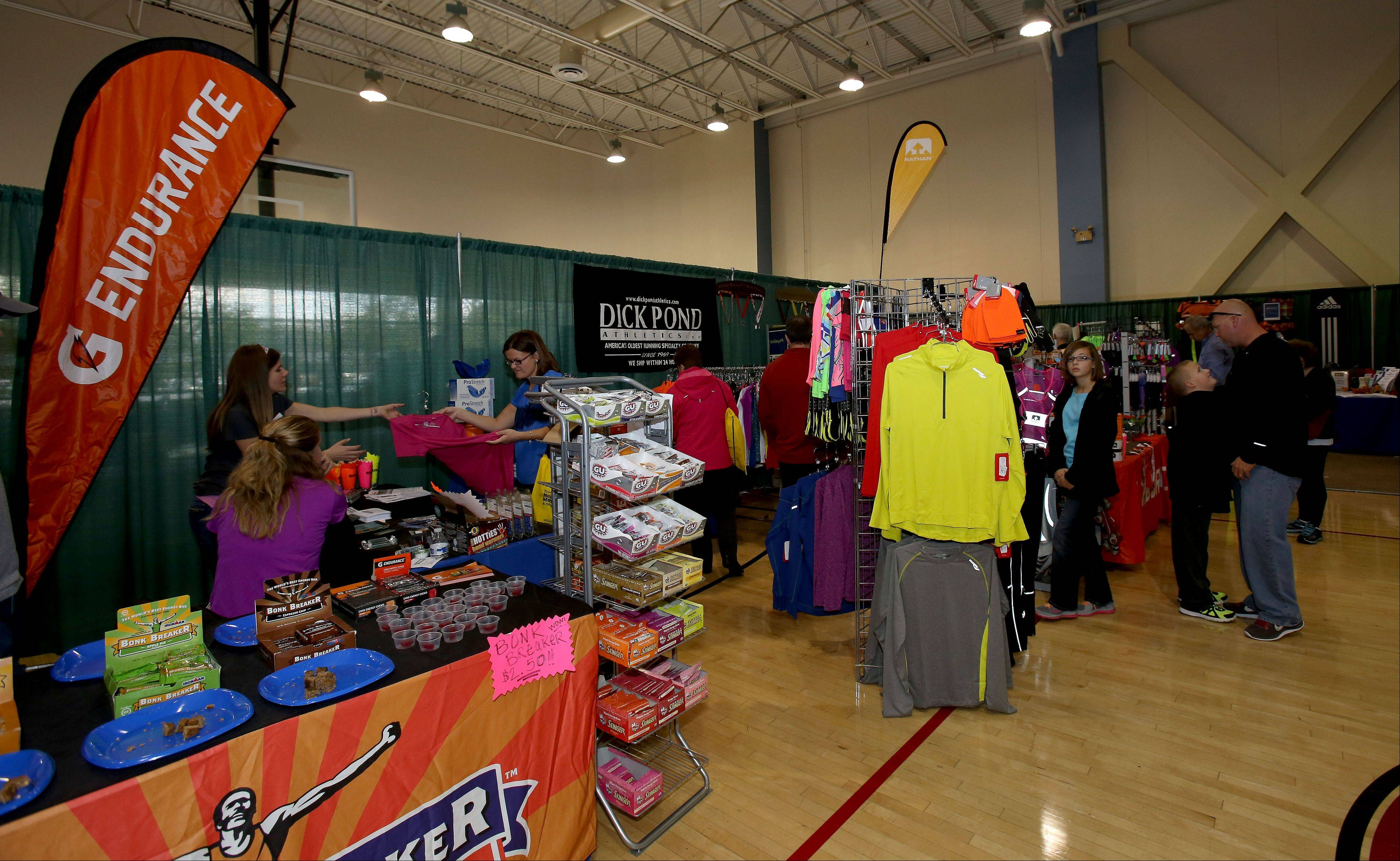 Runners in the inaugural Edward Hospital Naperville Marathon and Half Marathon are ready to race beginning at 7 a.m. Sunday at North Central College after picking up their packets and bibs at the race expo Friday and Saturday.