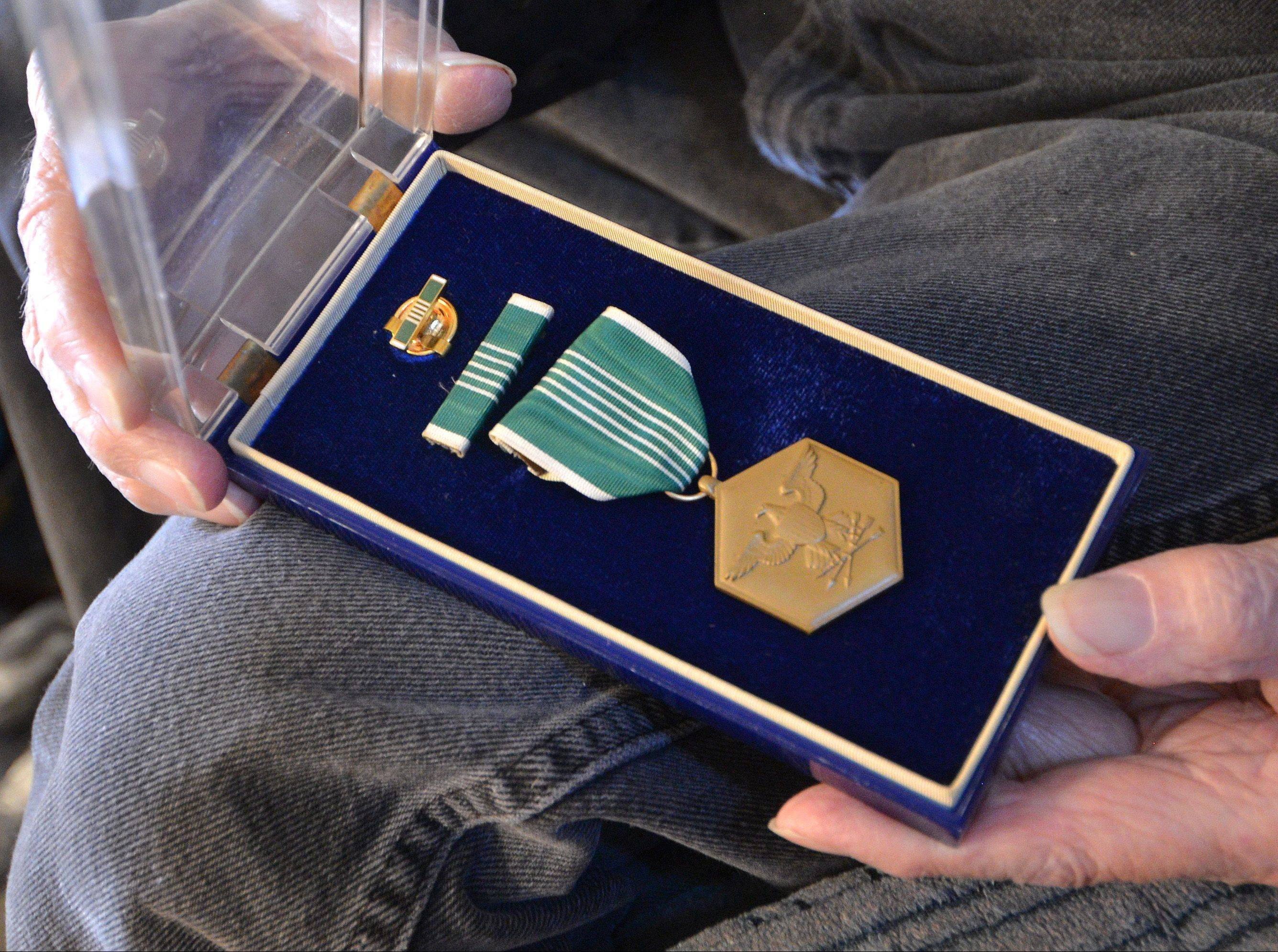 "Even though he was awarded The Commendation Ribbon With Pendant for meritorious service, Korean War veteran Virgil Banker jokes that ""it costs me the same for a cup of coffee as it does you."""