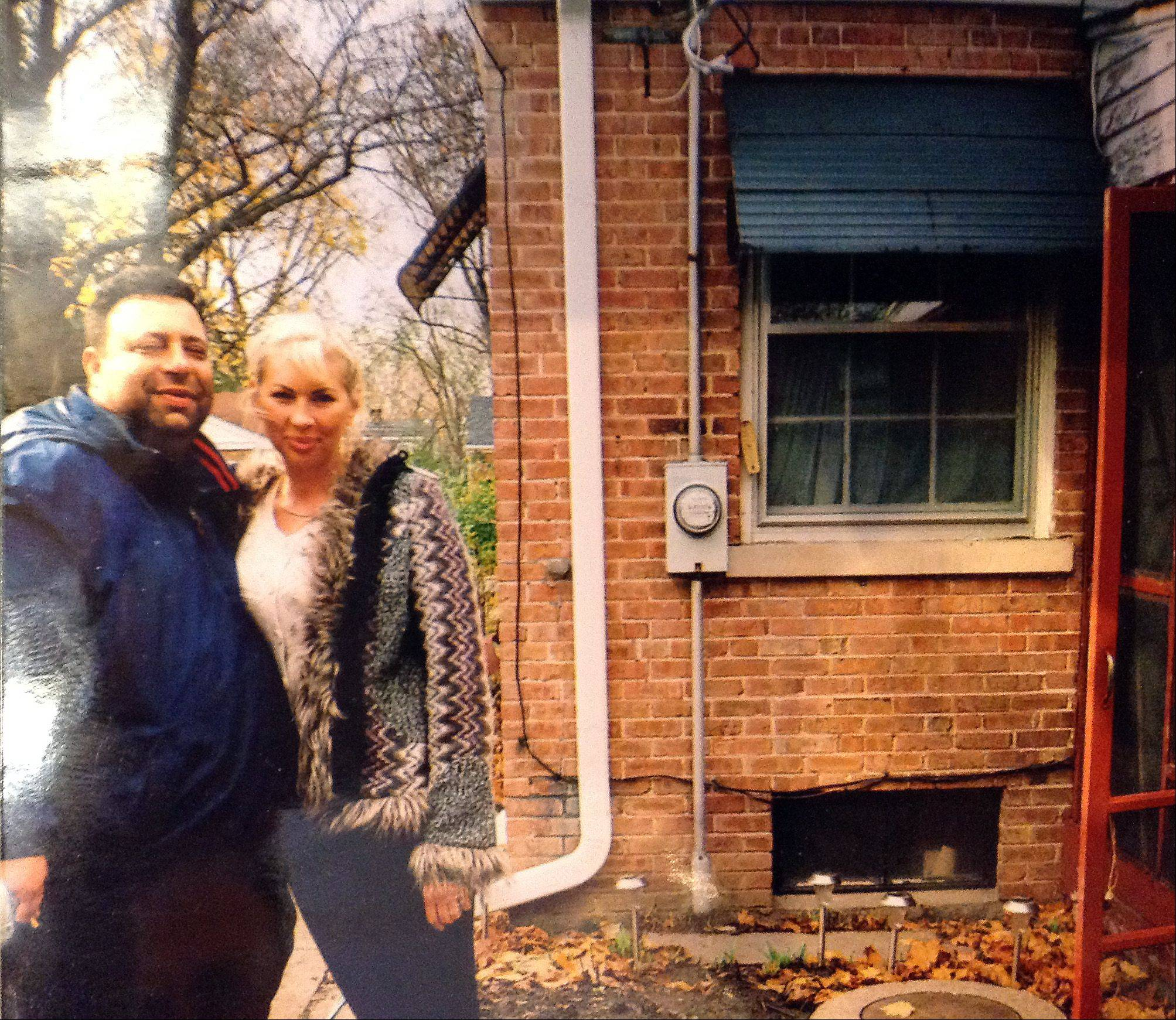 Posing for this photo in back of the Arlington Heights home where she would die in a fire, Svitlana and Alex Kandelis had planned for her to renew the medical technician career she had in their Ukranian homeland.
