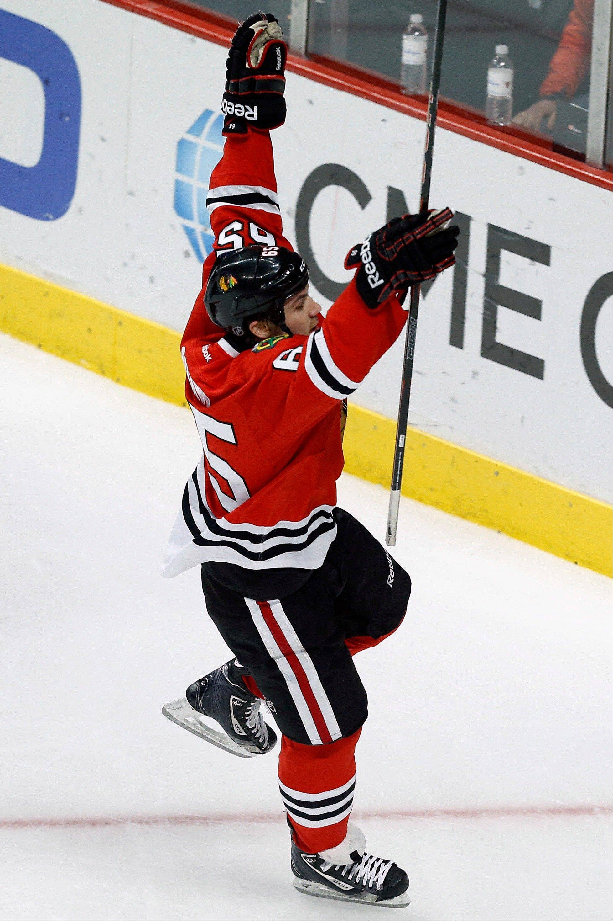 The Hawks' Andrew Shaw celebrates after beating Oilers goalie Devan Dubnyk in the second period Sunday at the United Center.