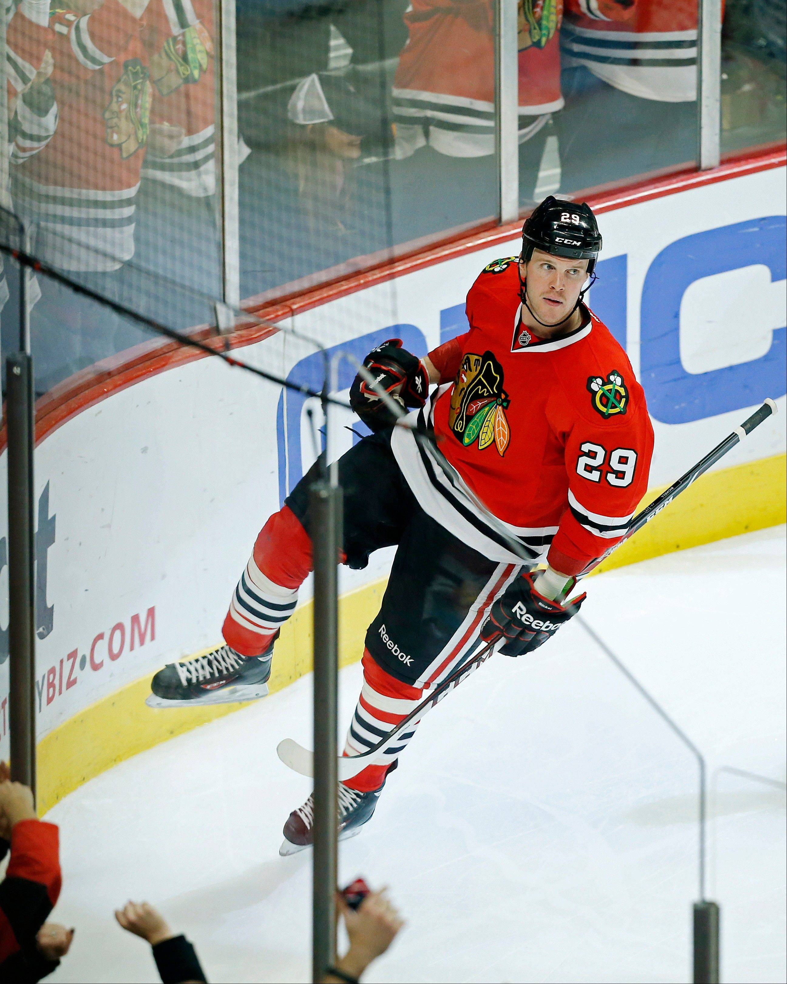 The Hawks' Bryan Bickell celebrates his third-period goal against the Oilers on Sunday at the United Center.