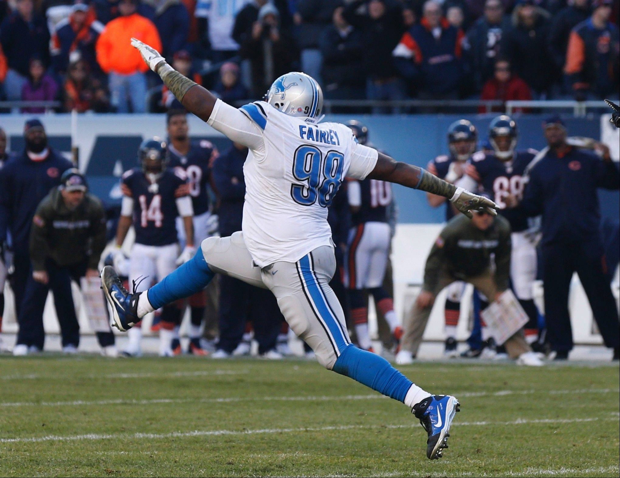 Lions defensive tackle Nick Fairley (98) celebrates after making a tackle against Chicago Bears during the second half of an NFL football game, Sunday, Nov. 10, 2013, in Chicago. The Lions won 21-19.