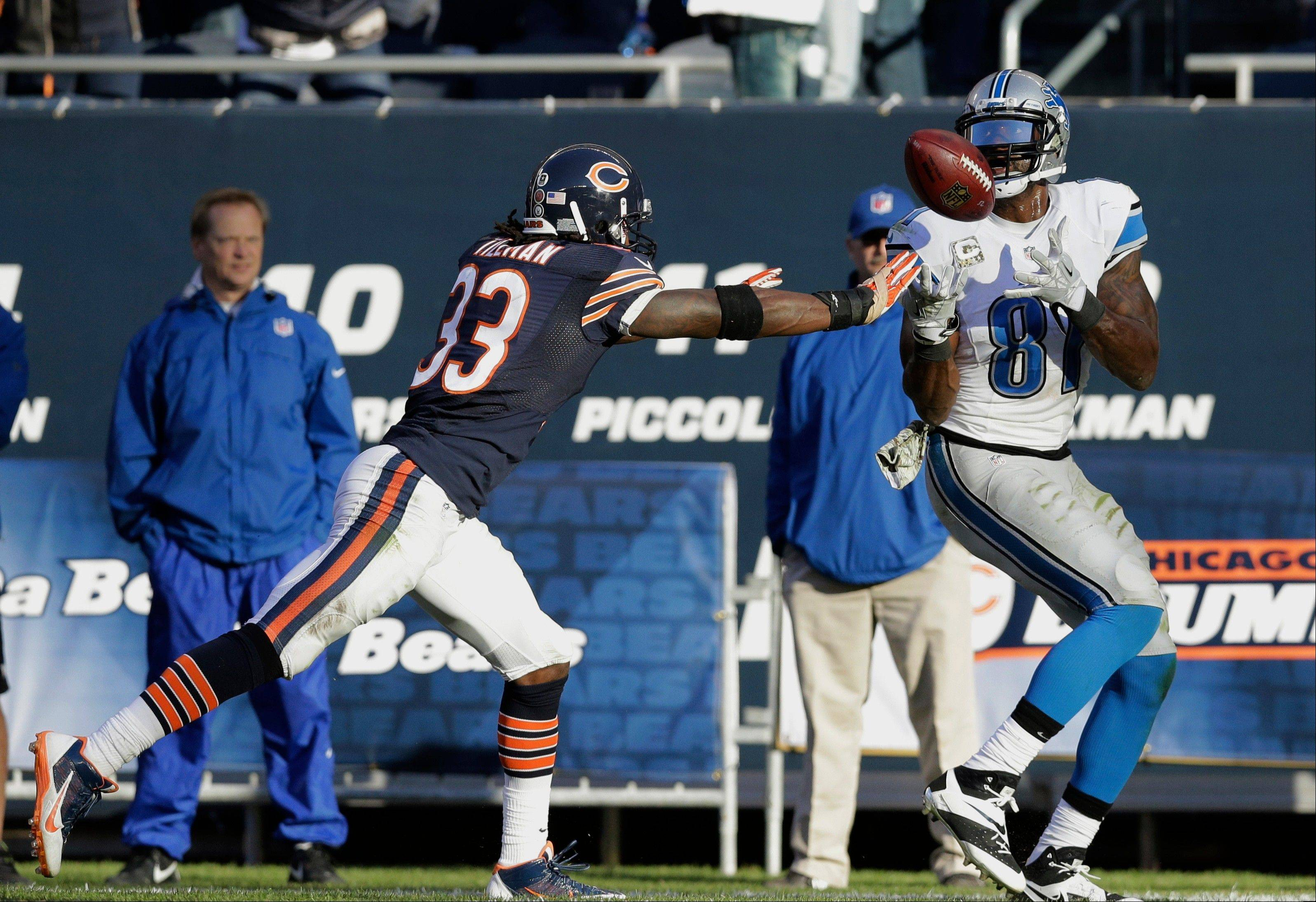 Detroit Lions wide receiver Calvin Johnson (81) makes a touchdown reception against Chicago Bears cornerback Charles Tillman (33) during the second half of an NFL football game, Sunday, Nov. 10, 2013, in Chicago.