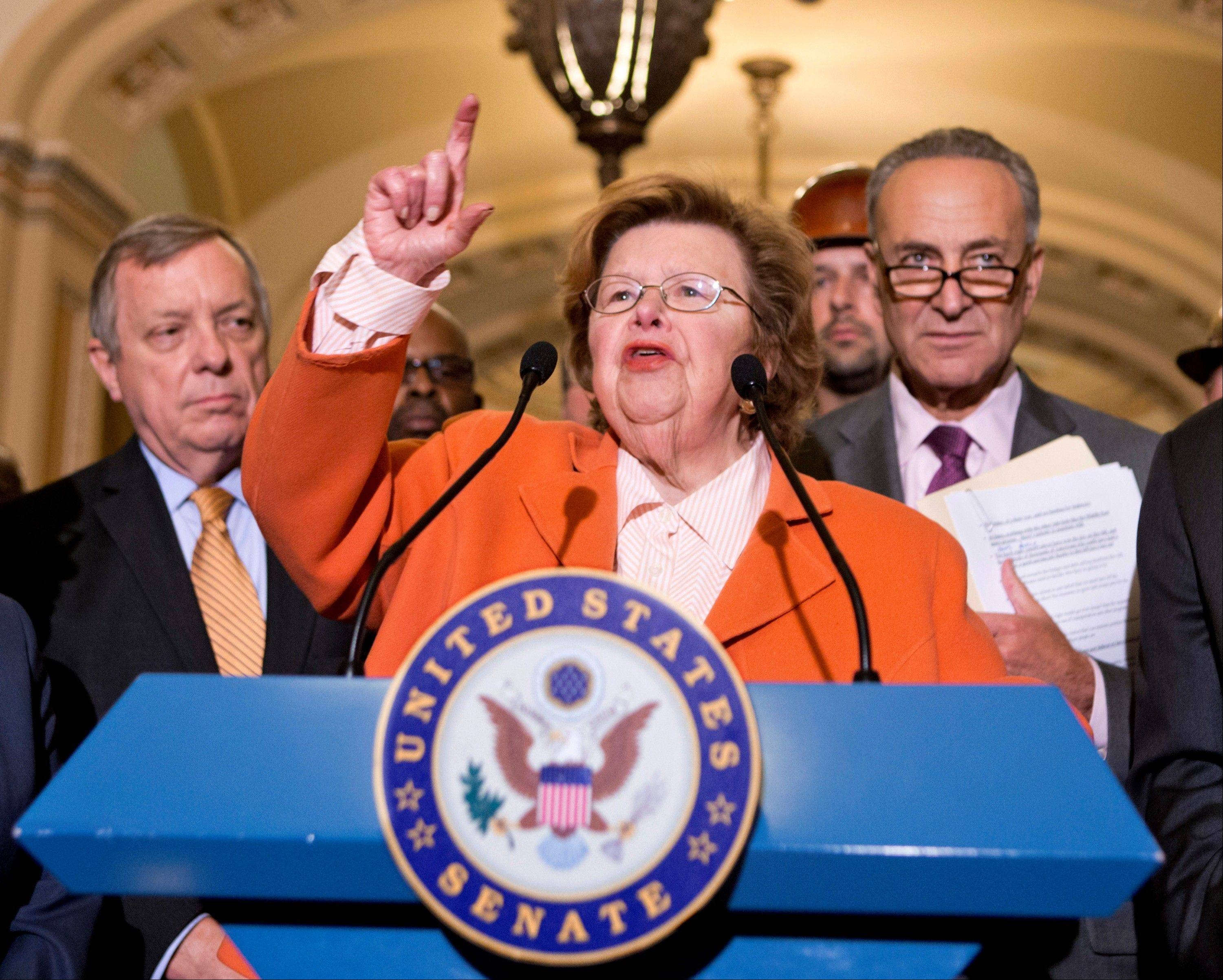 Senate Appropriations Committee Chair Barbara Mikulski of Maryland, flanked by Senate Majority Whip Richard Durbin of Illinois, left, and Sen. Charles Schumer, speaks on Capitol Hill in Washington.