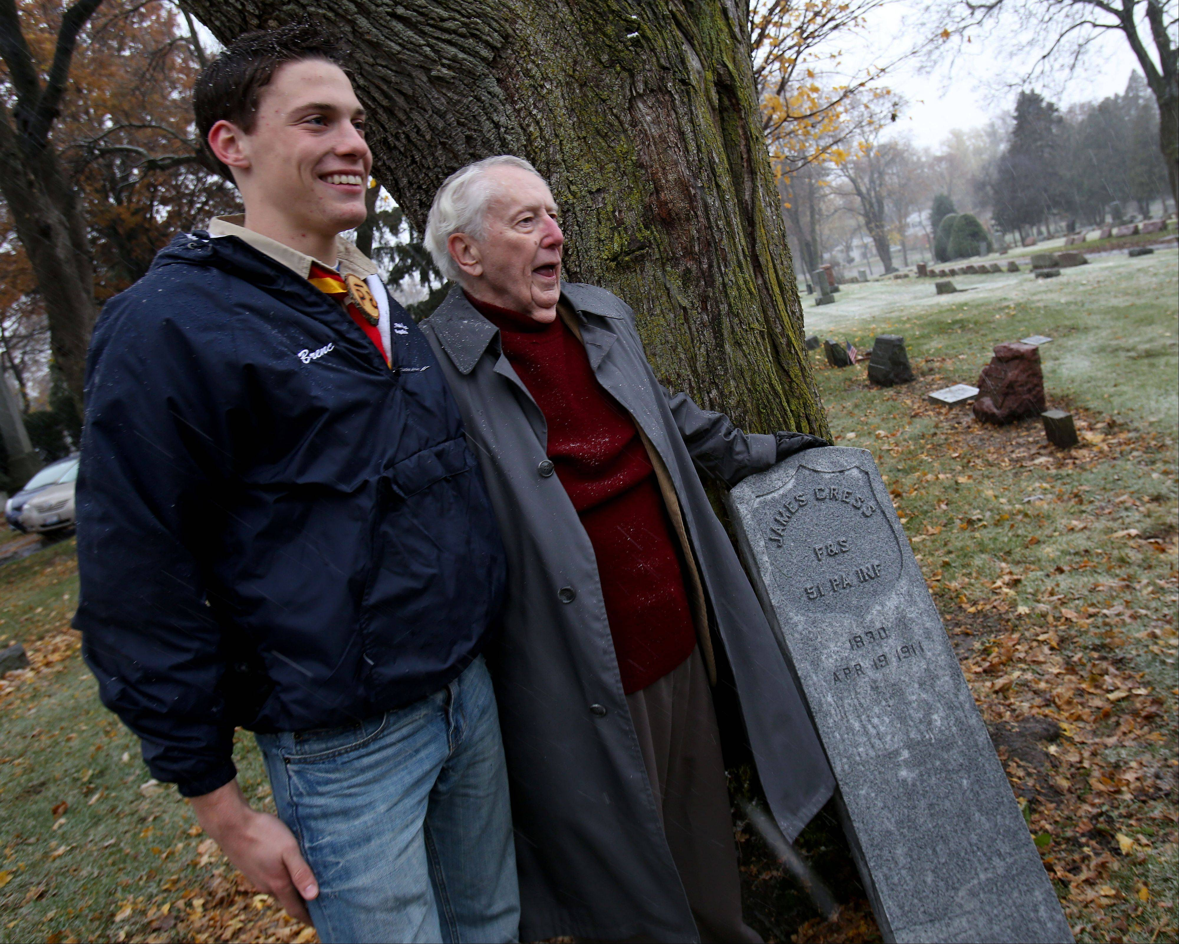 Boy Scout Josh Brenc stands Monday with James Malone of Wheaton at Wheaton Cemetery. As part of an Eagle Scout project, Brenc has secured a headstone for Malone�s great grandfather, Civil War veteran James Cress.