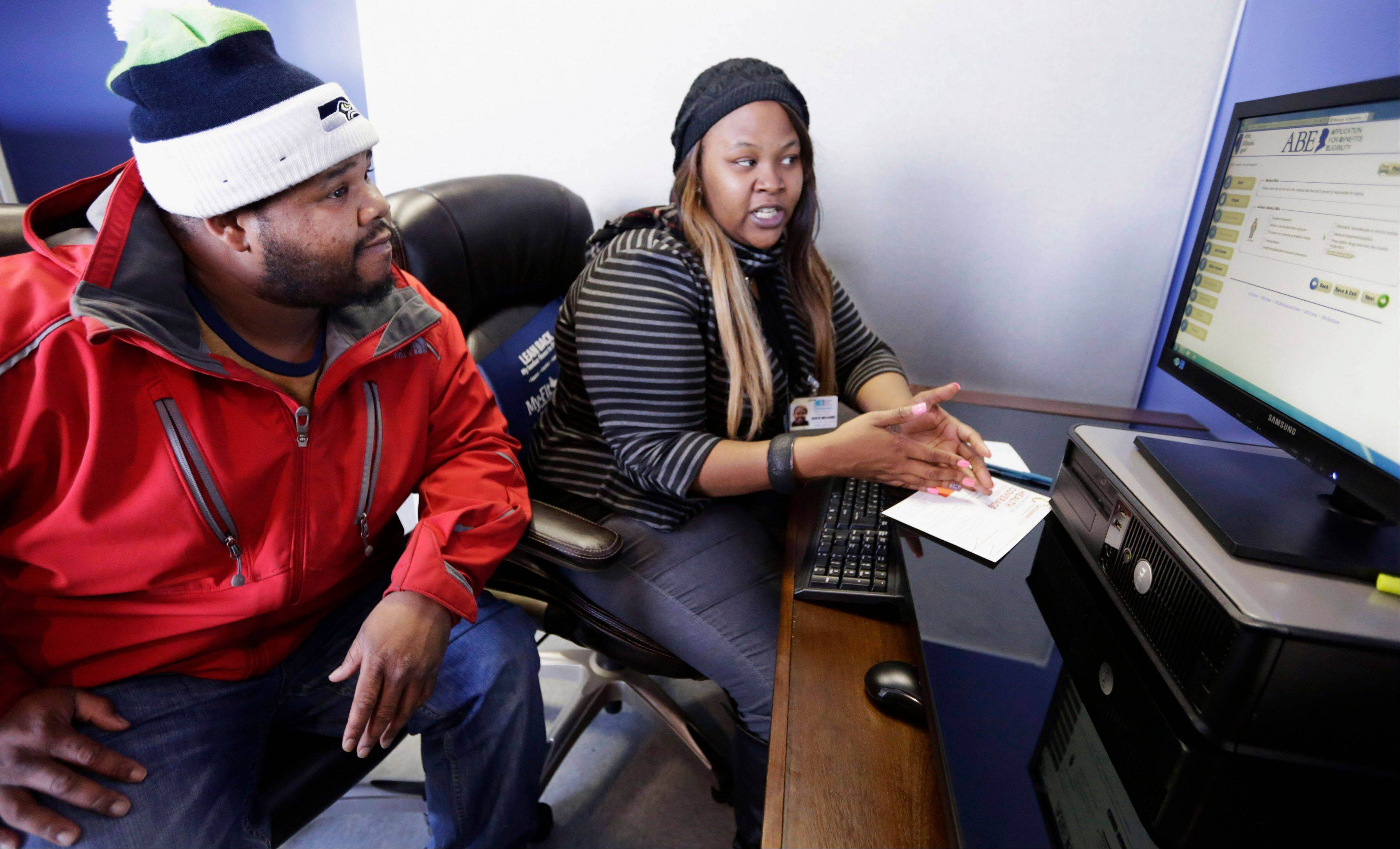 Enrollment counselor Kenya Williams helps Jerome Davis Jr. 36, sign up for Medicaid last week at the Westside Health Authority in Chicago. For Davis, an unemployed construction worker, expansion of Medicaid means he�ll be able to see a doctor without fear of medical bills he can�t pay.