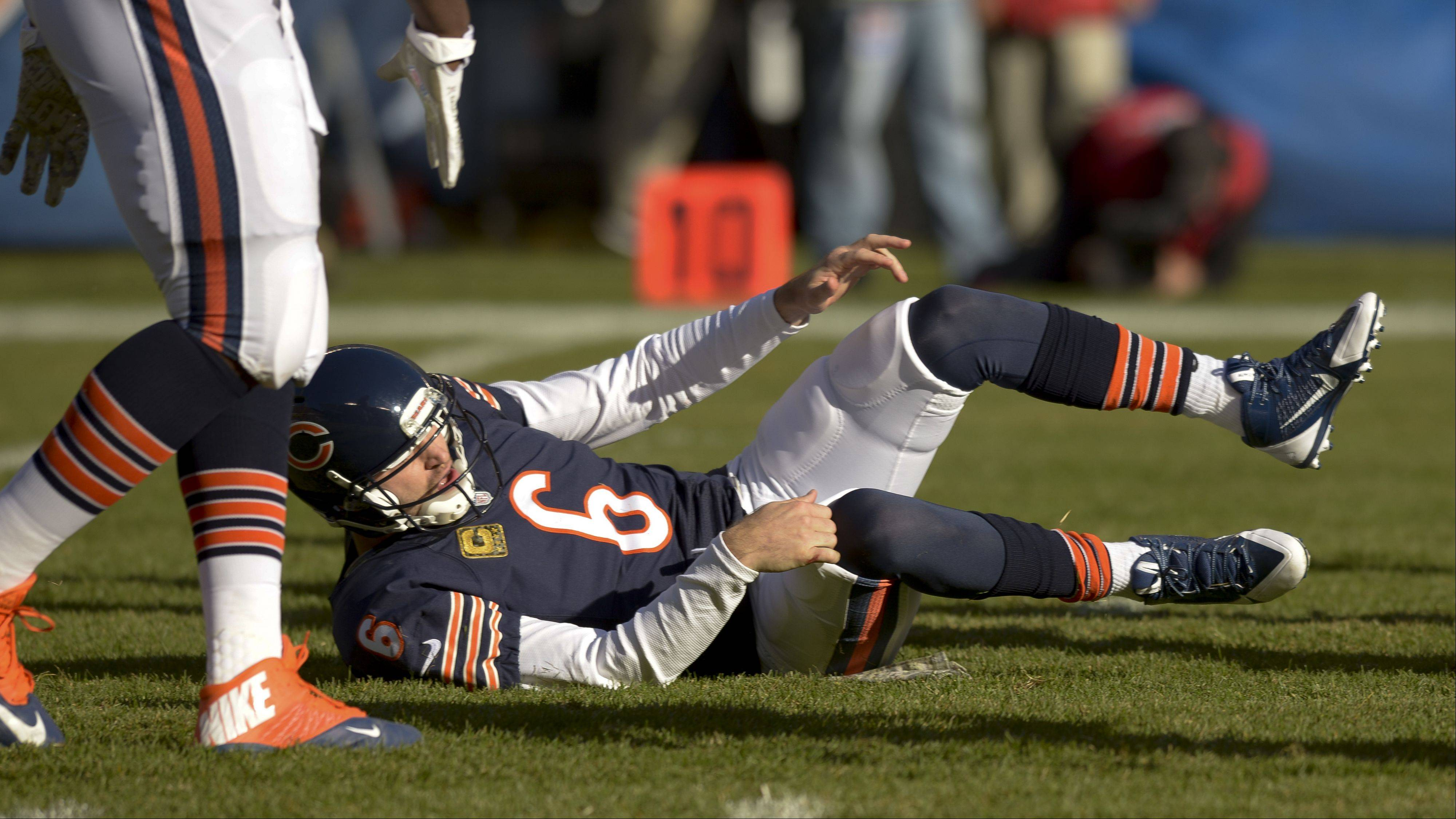 Chicago Bears quarterback Jay Cutler is slow to get up during the Bears 21-19 loss Sunday against the Detroit Lions at Soldier Field. Cutler would ultimately leave the game, and the Bears would leave their first place ranking behind.