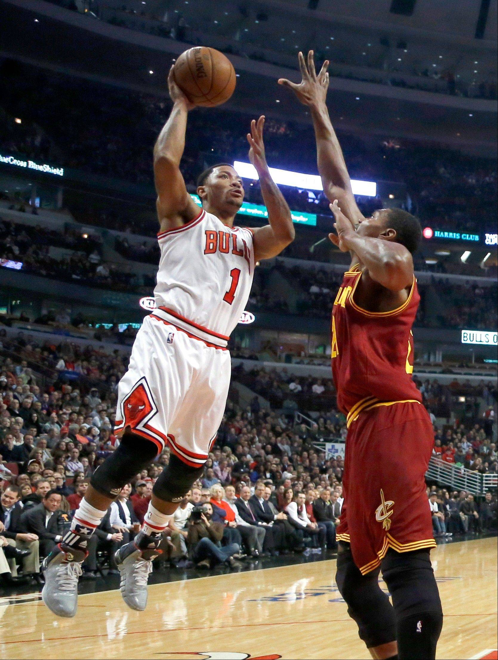 The Bulls� Derrick Rose shoots over Cleveland�s Andrew Bynum during the first half Monday night at the United Center. Rose sat out the final three minutes of the Bulls� victory after suffering a hamstring injury.